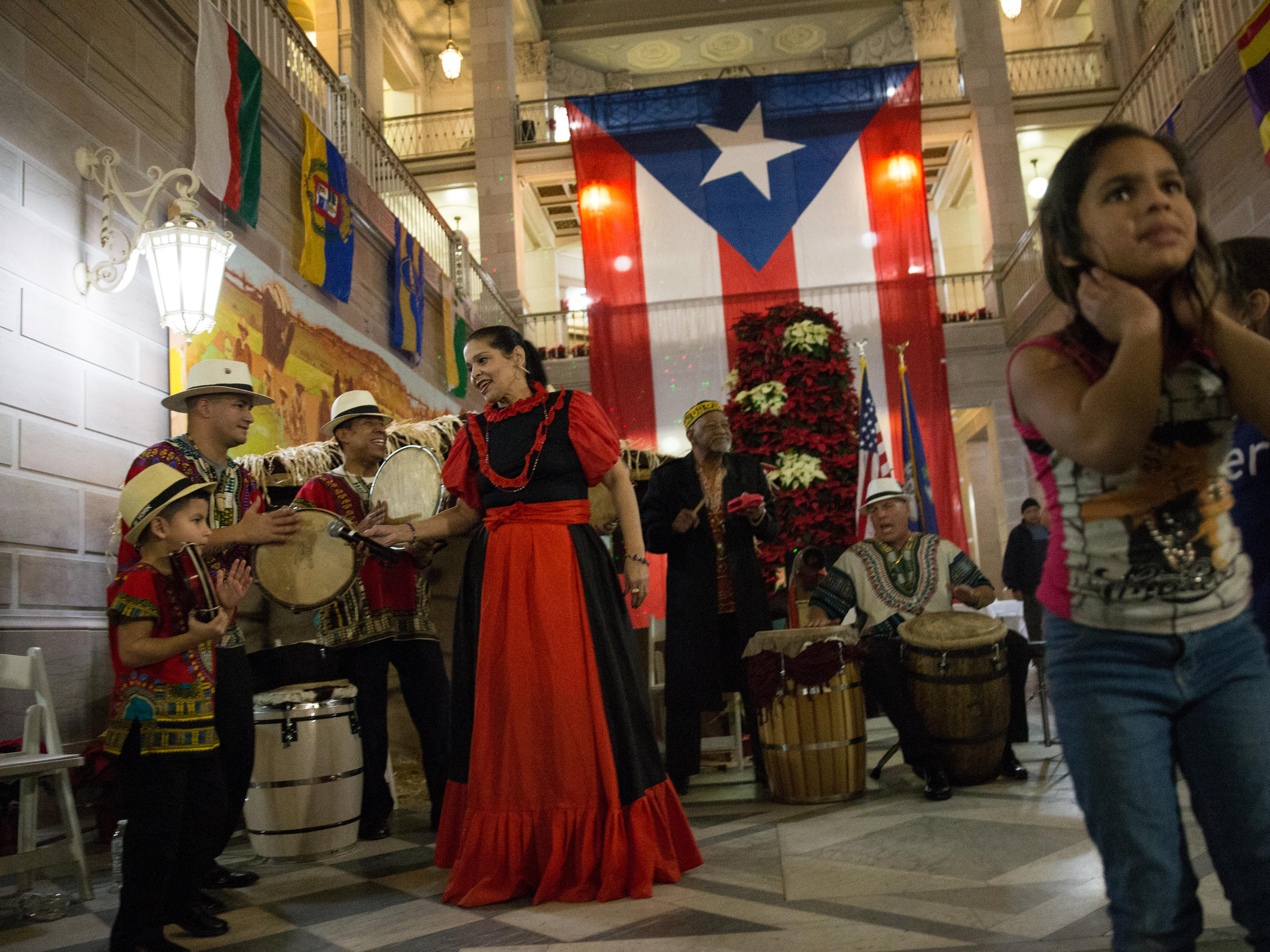 We Feel Like Home\': Displaced Puerto Ricans Celebrate Traditional ...
