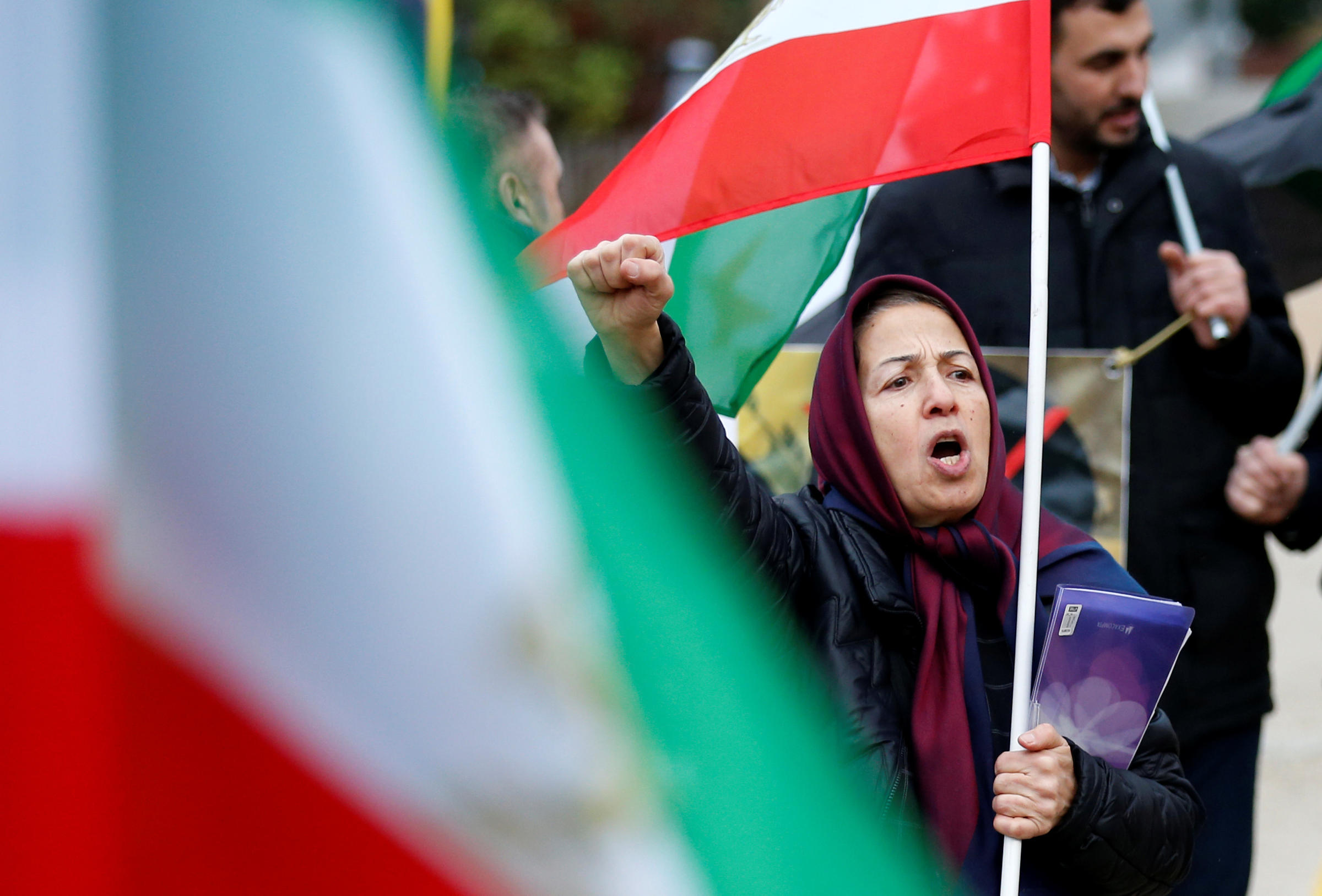 A protester chants slogans against the Iranian government outside the European Union Council in Brussels Belgium on Wednesday