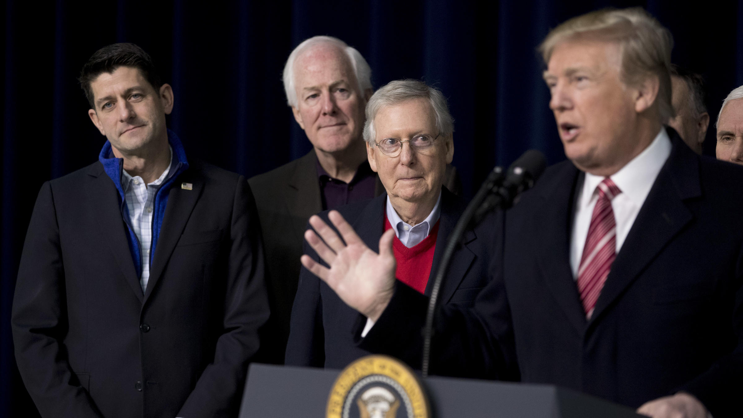 President Trump with House Speaker Paul Ryan of Wis. Senate Majority Whip John Cornyn R-Texas. and Senate Majority Leader Mitch Mc Connell of Ky. speaks to reporters after a retreat where GOP leaders made plans for a 2018 agenda