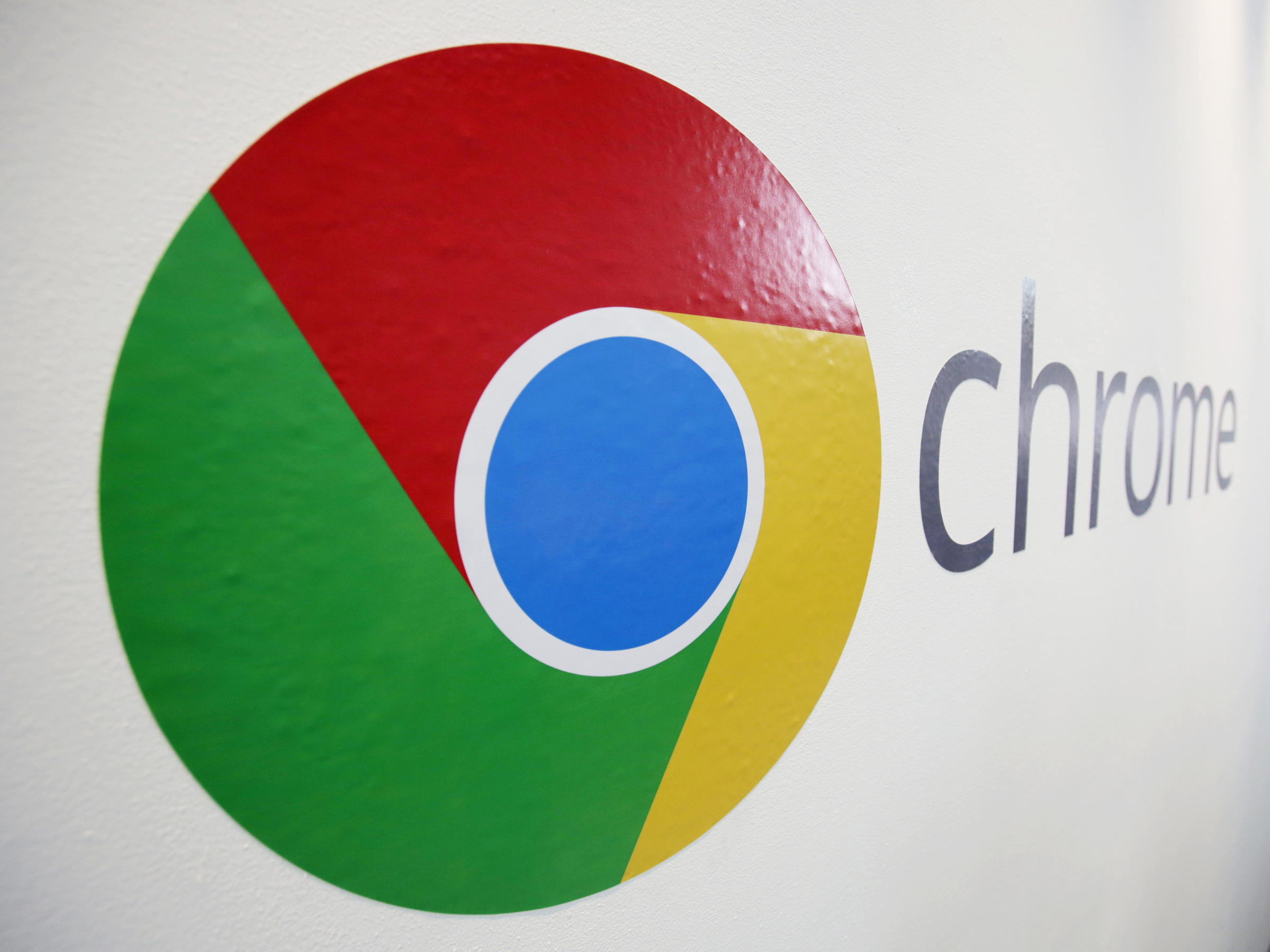 The Chrome logo is displayed at a Google event in New York in 2013