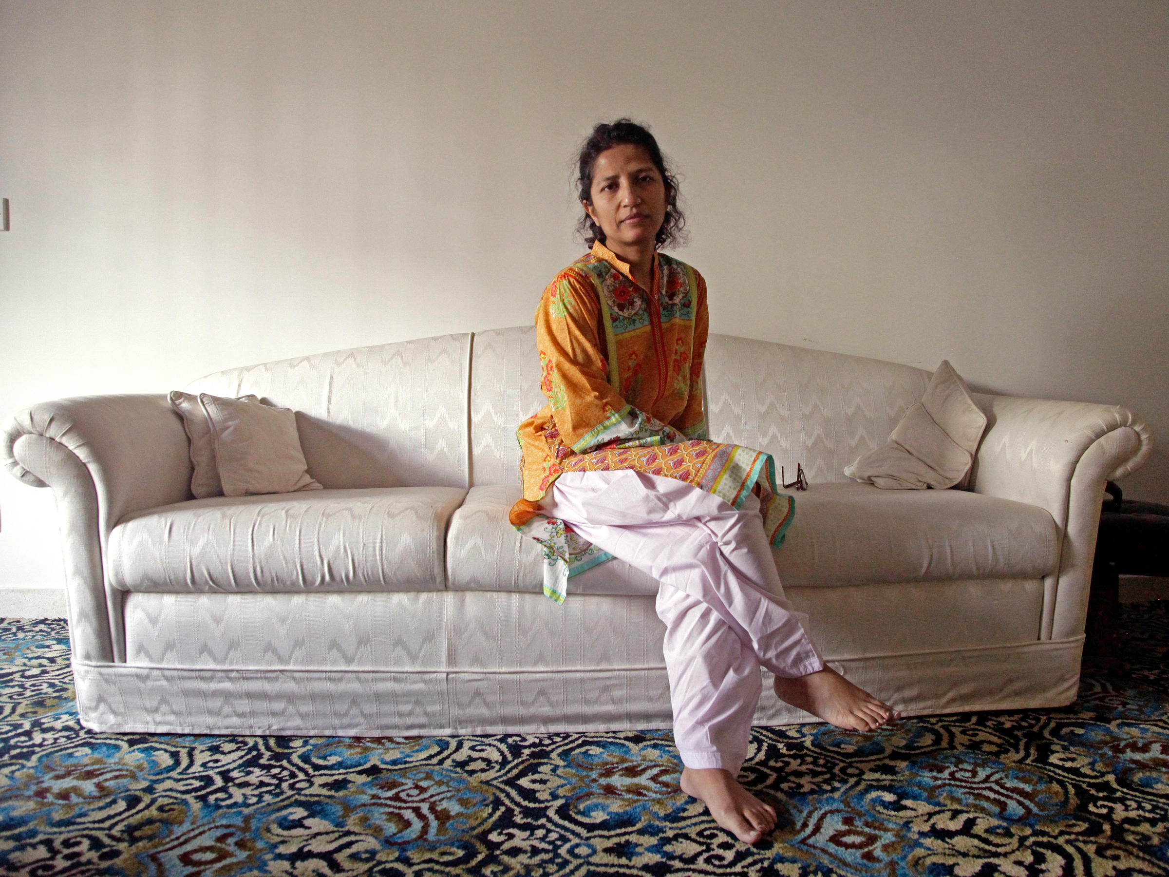 f45e45186bc01 Leena Khandwalla, 44, at her family home in Karachi, Pakistan. After members  of her religious community in the U.S. and Australia were arrested for ...
