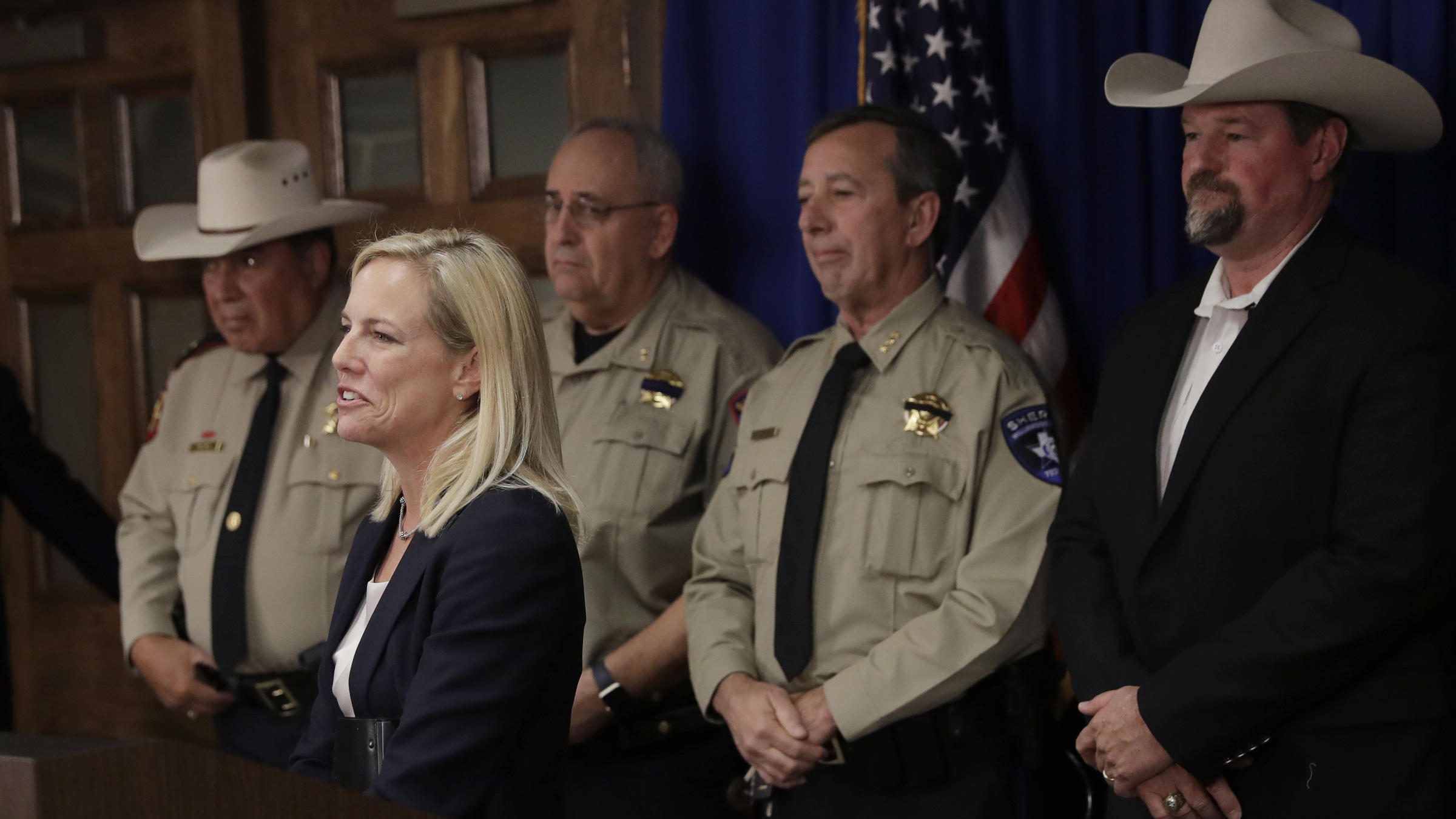 Secretary of Homeland Security Kirstjen Nielsen stands with a group of Texas sheriffs opposing sanctuary-city policies in December in Austin