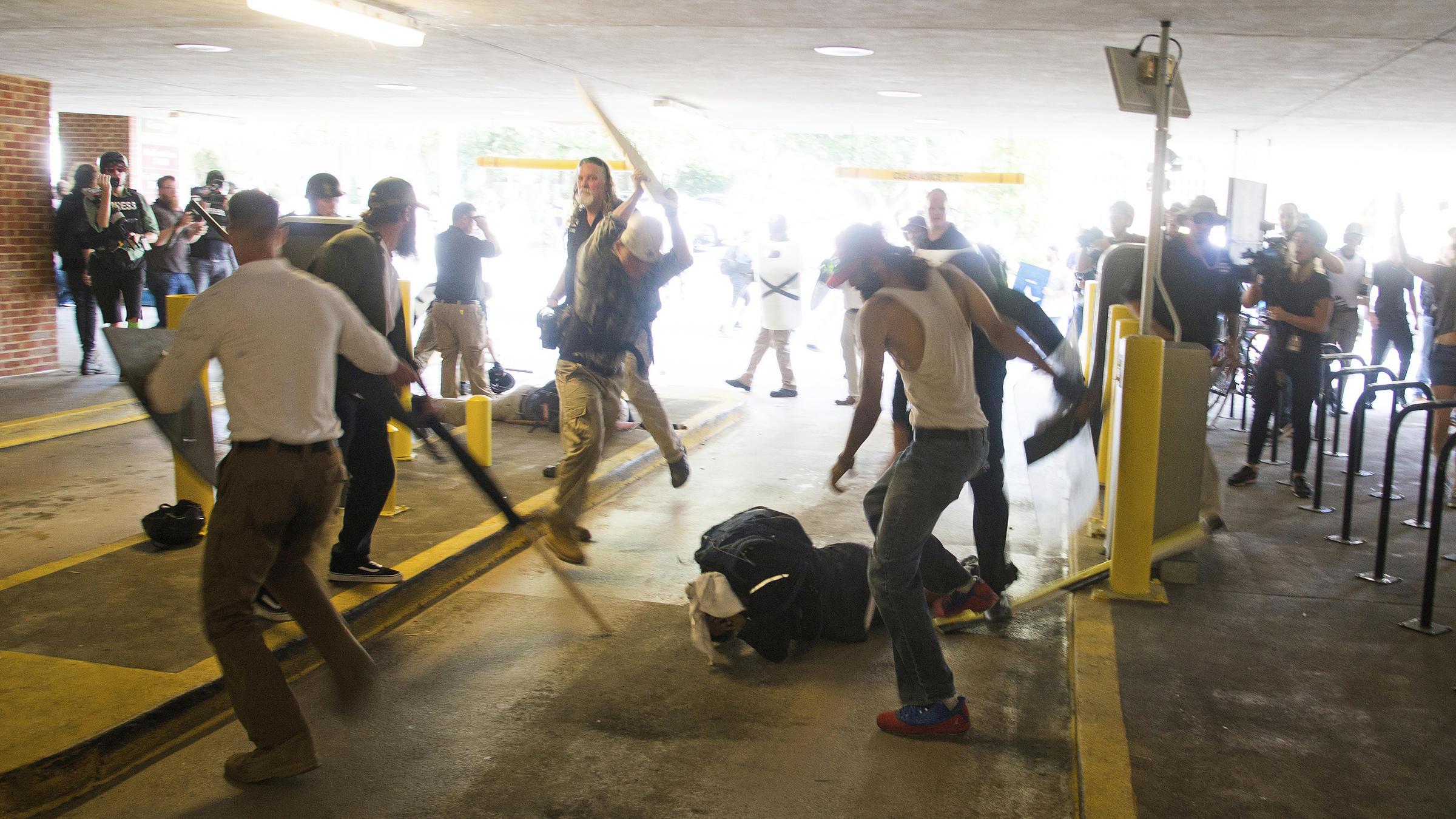 Black man beaten at Charlottesville rally 'cleared of assault'