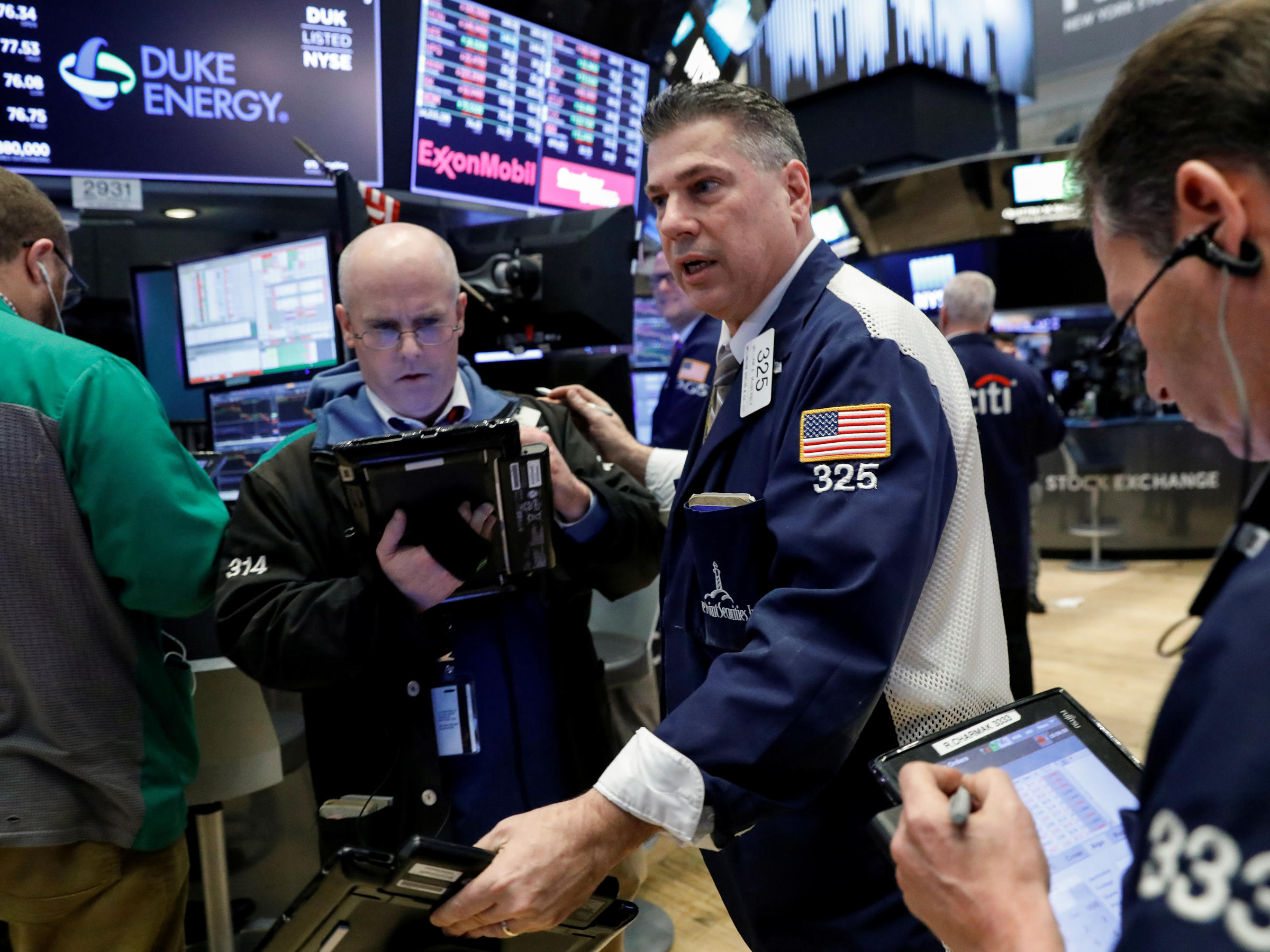 Stocks drop after Trump tariff action, but off lows