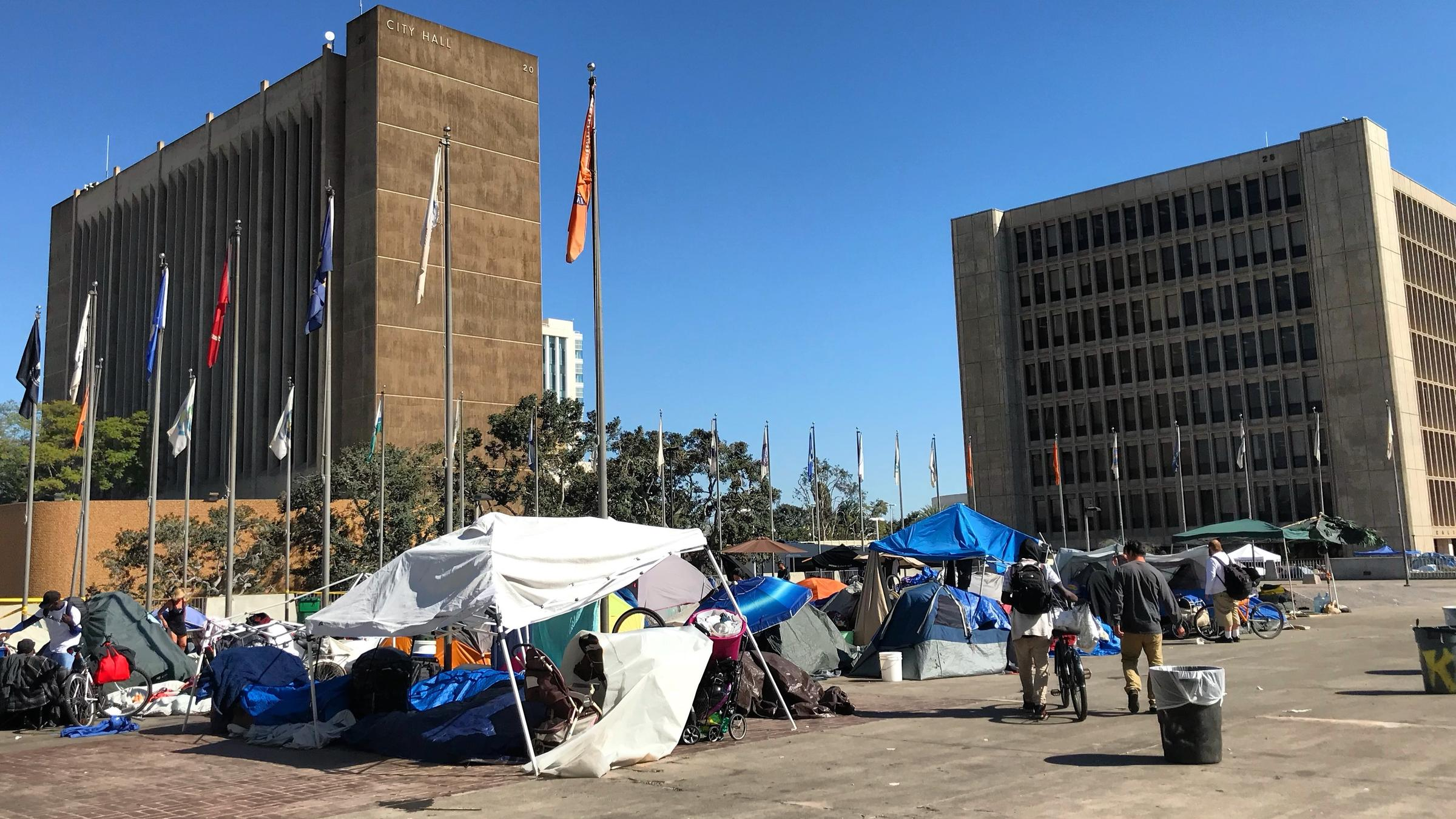 Orange County officials rescinded plans to establish three temporary shelters on county land near the ocean. Two blocks away from the hearing in Santa Ana a sprawling homeless encampment remains in front of the courthouse