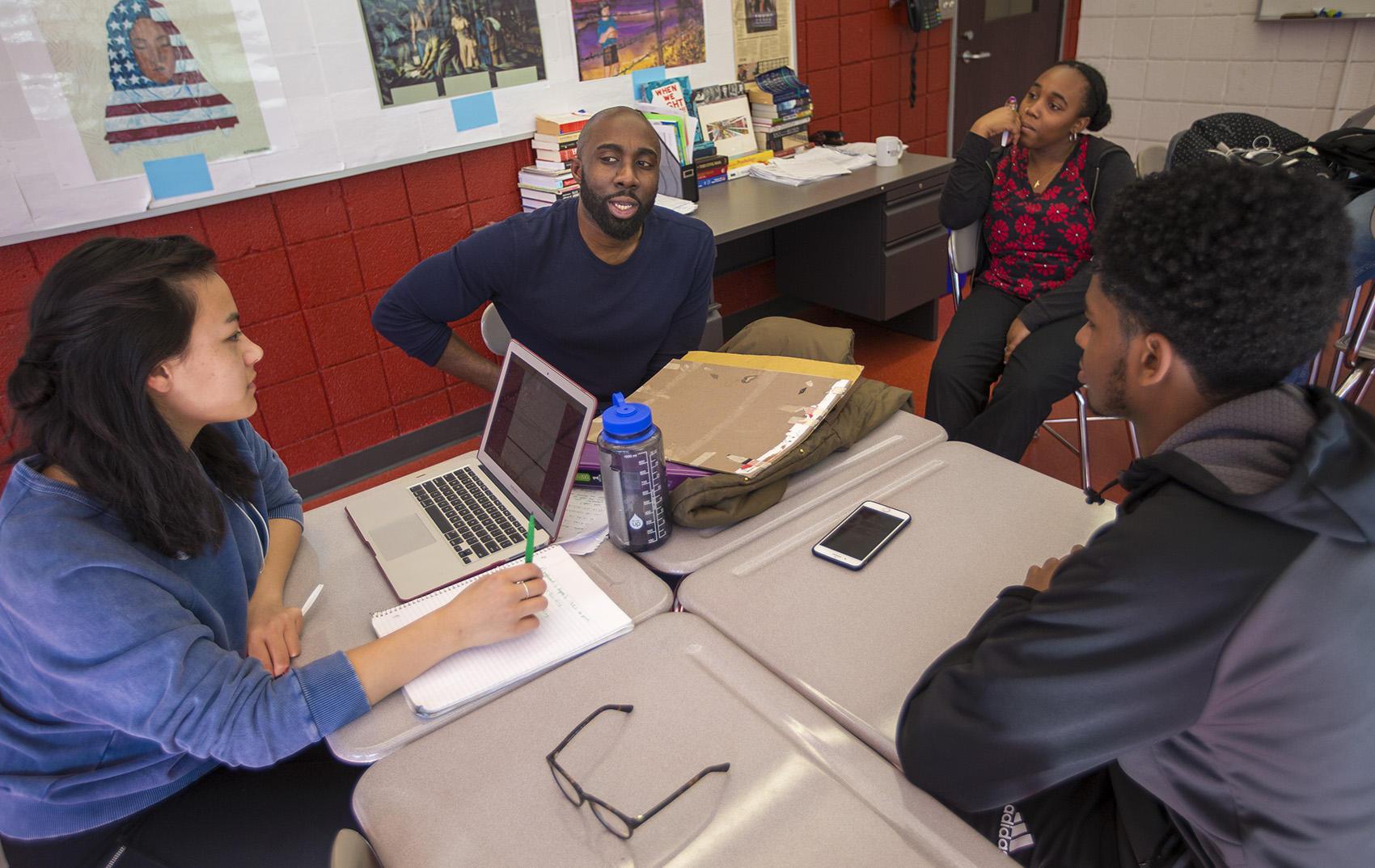 Cambridge Rindge and Latin School history teacher Kevin Dua, speaks with  students of the Black Student Union. (Jesse Costa/WBUR)
