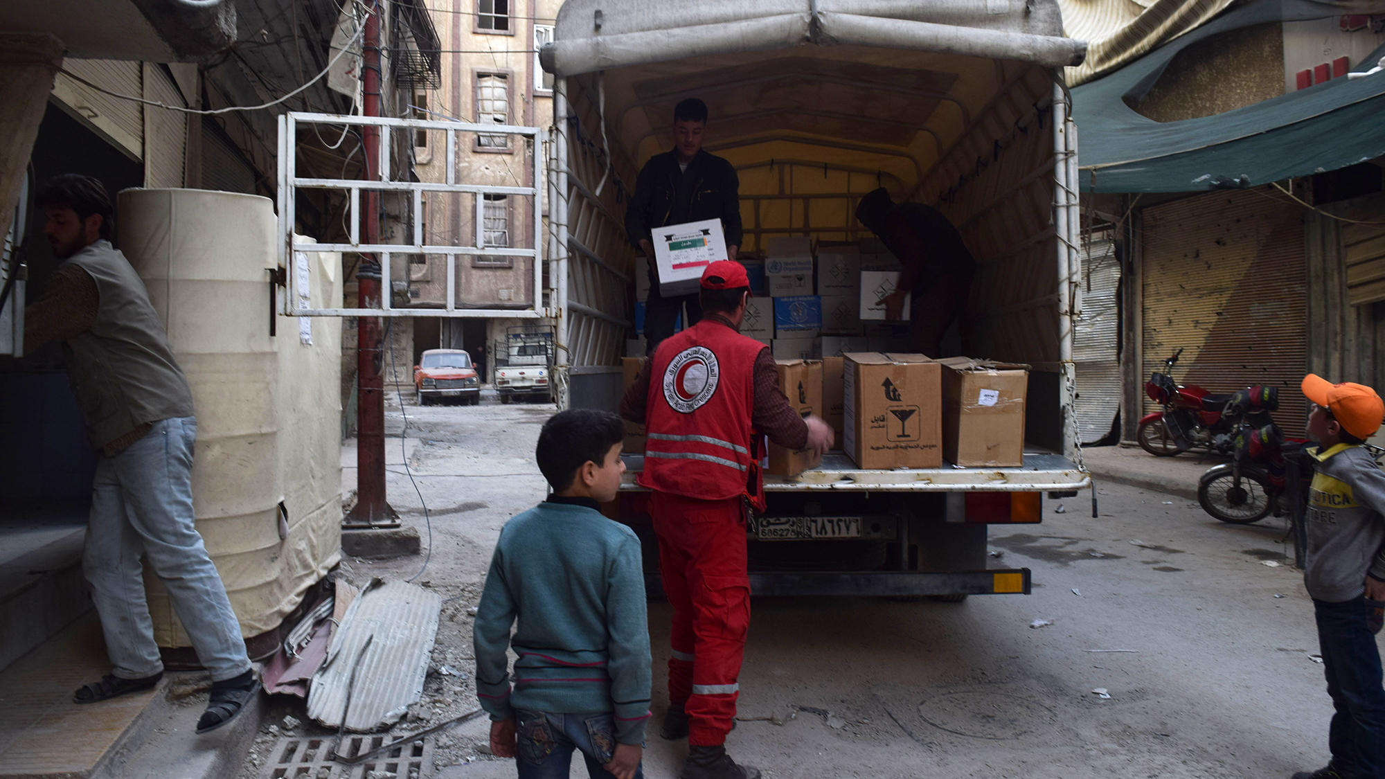 A U.N. convoy carrying aid enters Douma a besieged town in eastern Ghouta Syria in March