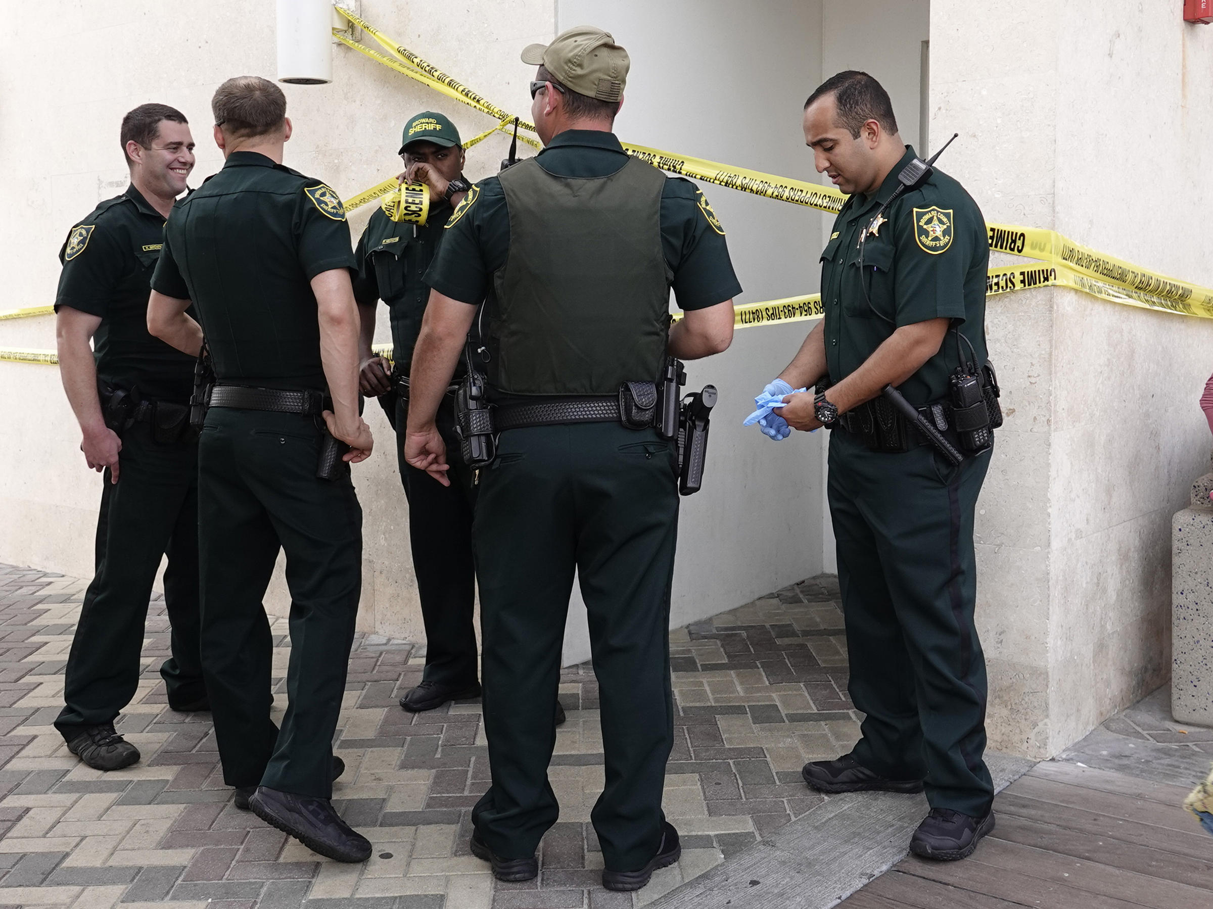 broward sheriff deputies surround the mens bathroom at the deerfield beach fishing pier on sunday