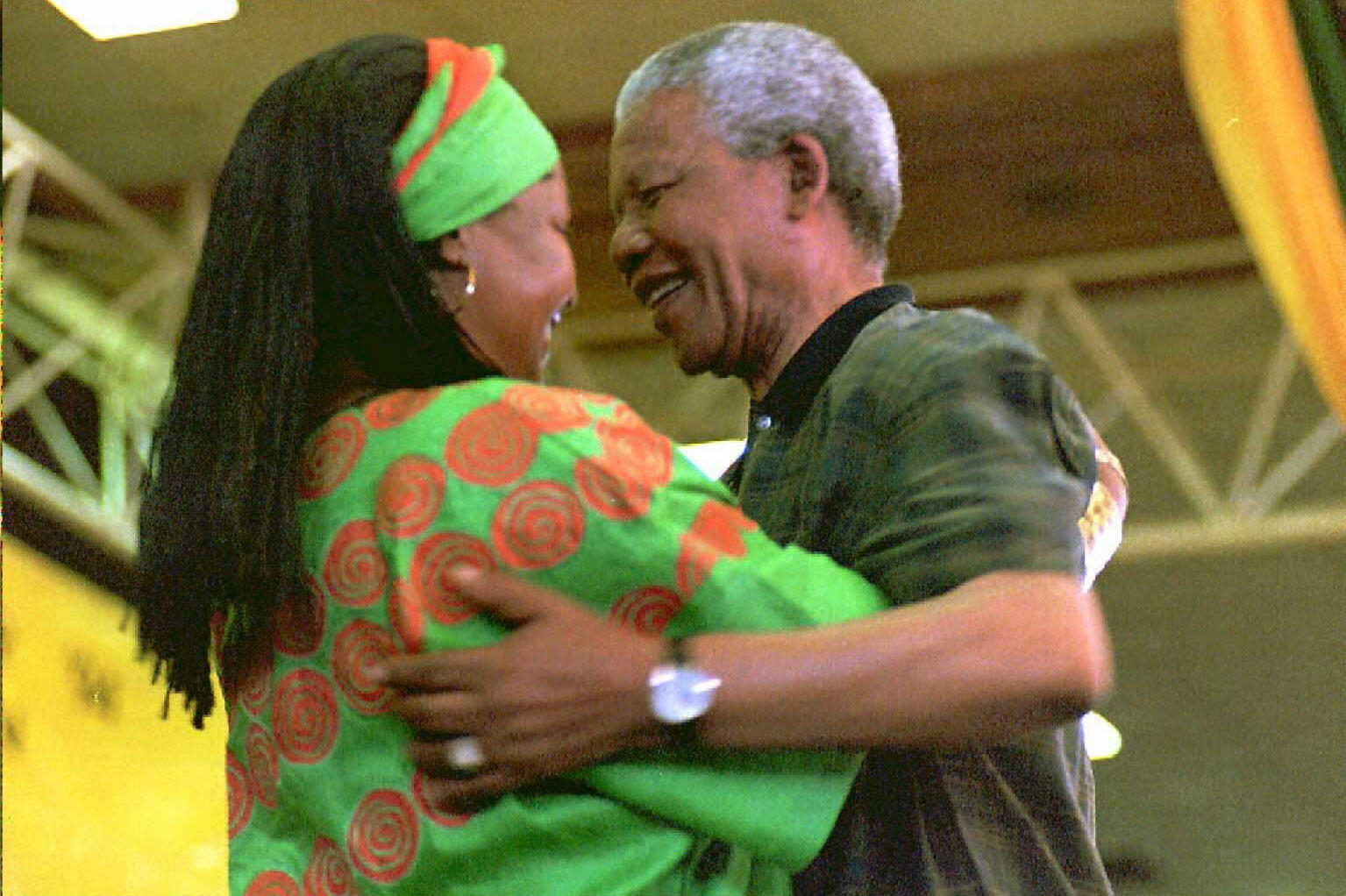 Nelson Mandela congratulates Winnie after her election to the National Executive Committee of the African National Congress on the last day of its 49th constitutional congress in Bloemfontein South Africa December 1994. The Mandelas separated in 1992