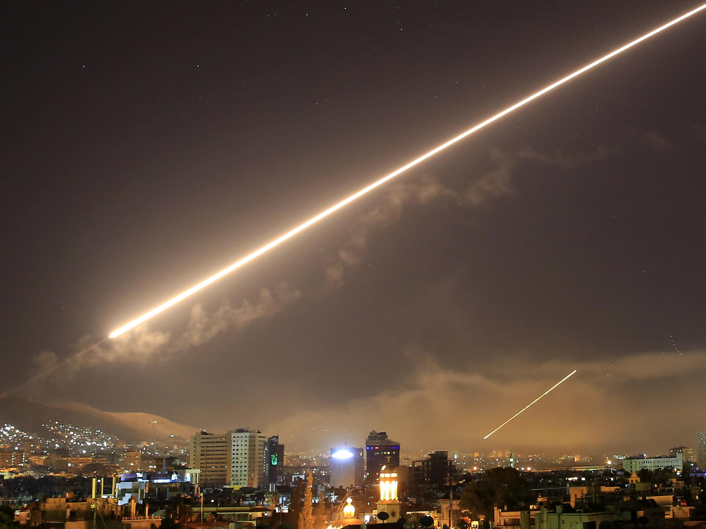 A surface-to-air missile lit up the sky in Damascus early Saturday morning after President Trump announced airstrikes would be launched to deter the Syrian government for allegedly using chemical weapons