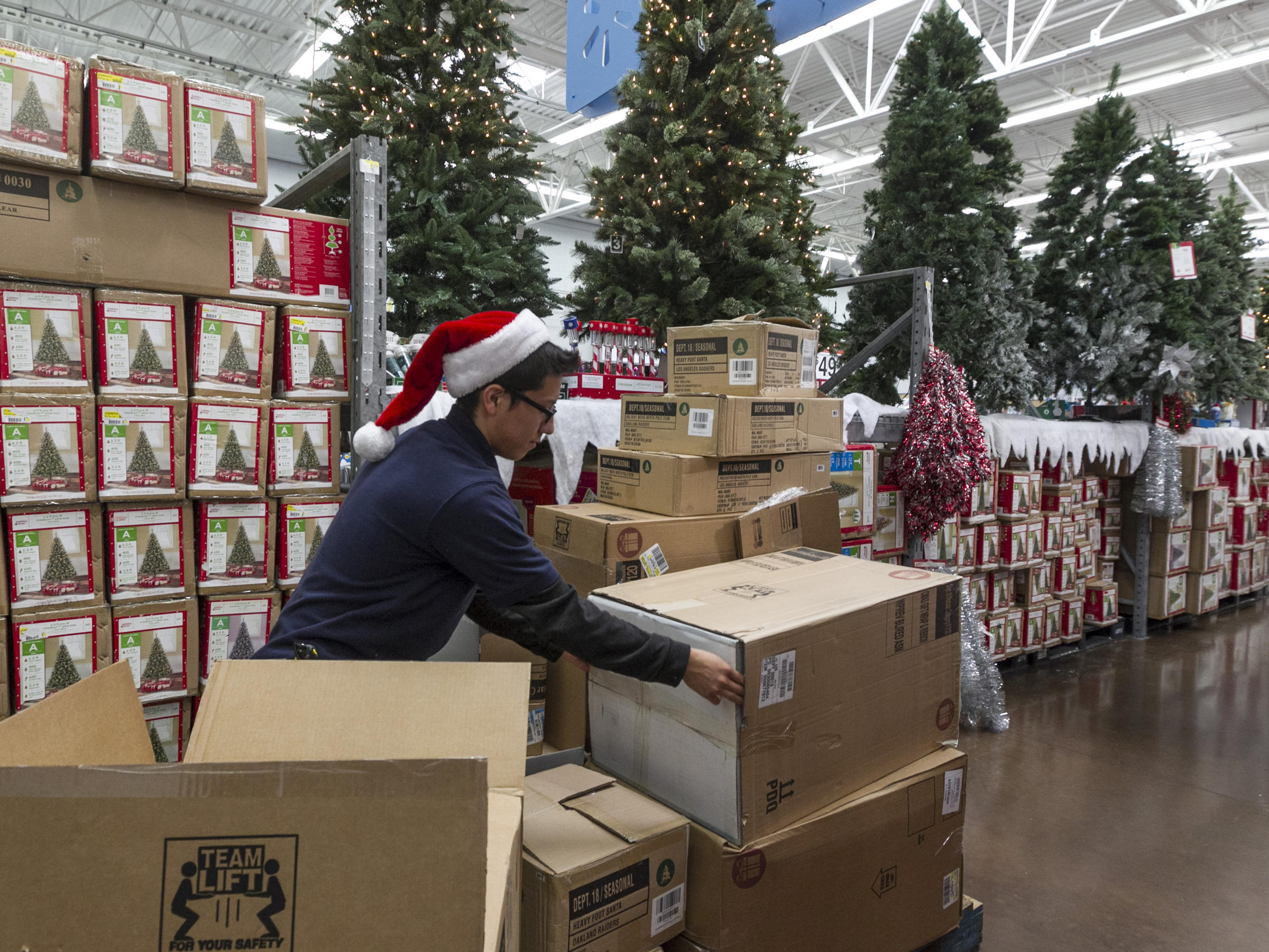 walmart associate angel campos stocks christmas decorations wednesday ahead of the pre black friday event at the wal mart supercenter store in rosemead