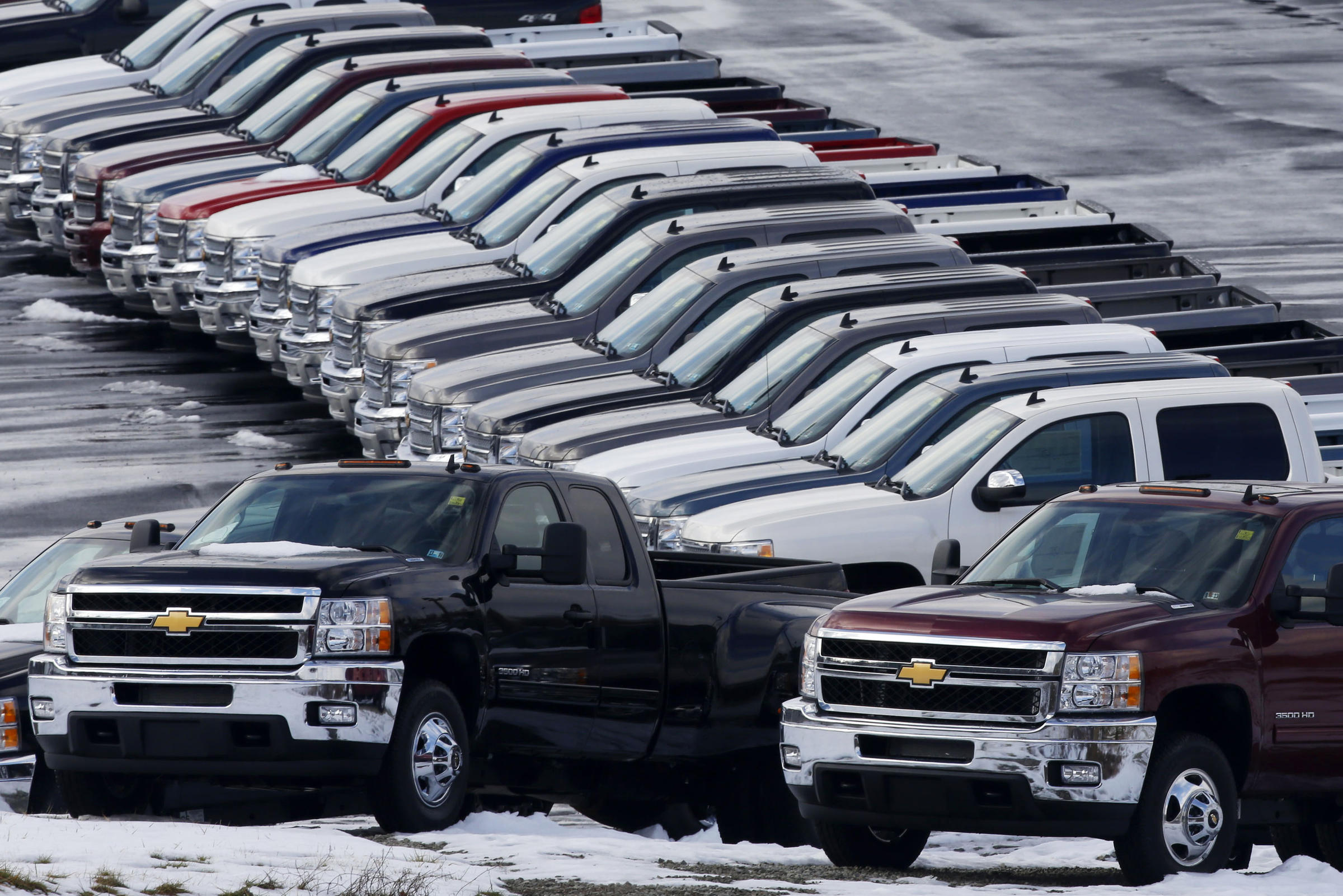 Chevy trucks line the lot of a dealer in Murrysville, Pa. Sales were up by double digits at Chrysler, General Motors and Ford last month.