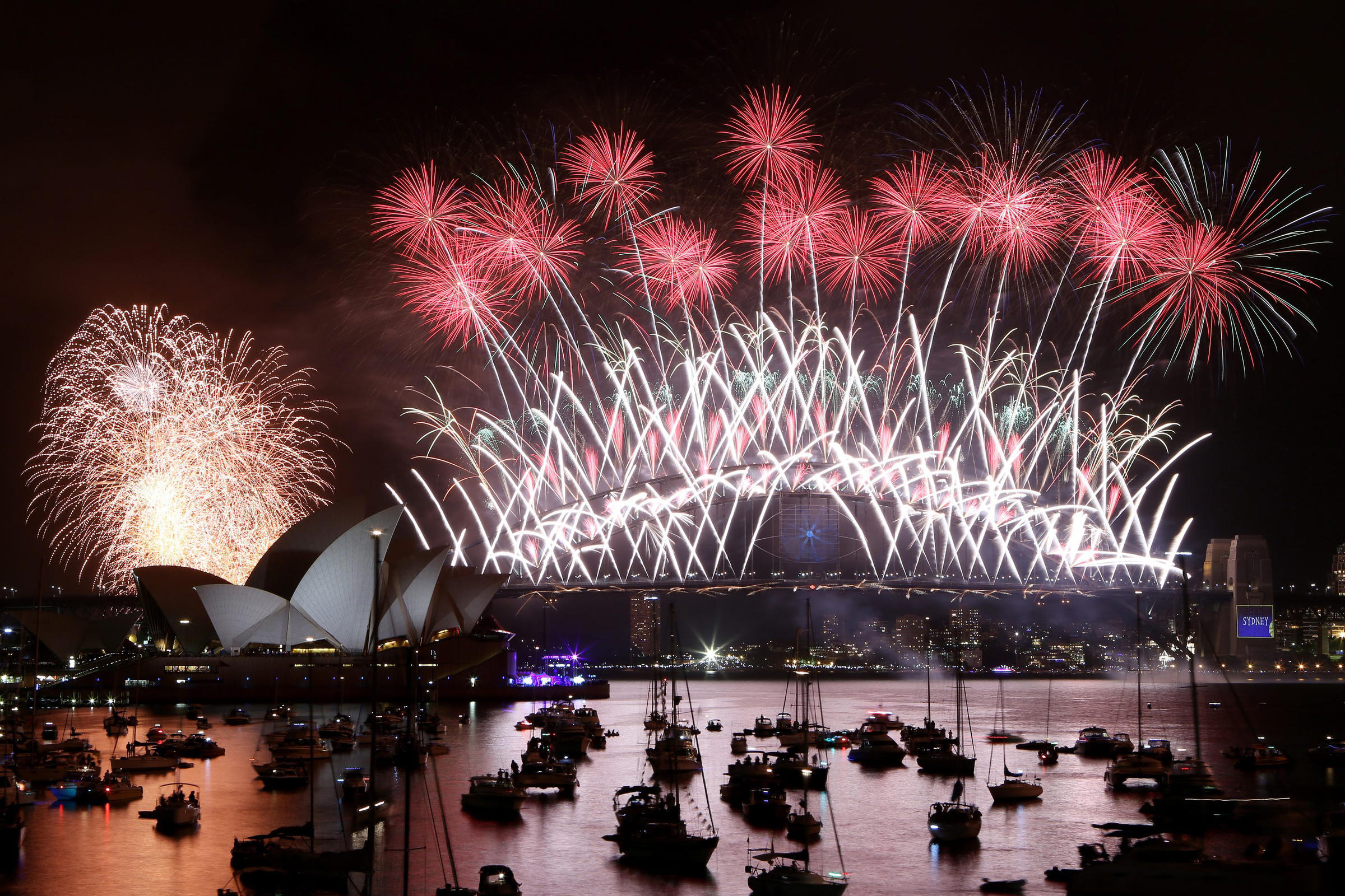 a view of the new years eve fireworks display in sydney harbor in sydney australia