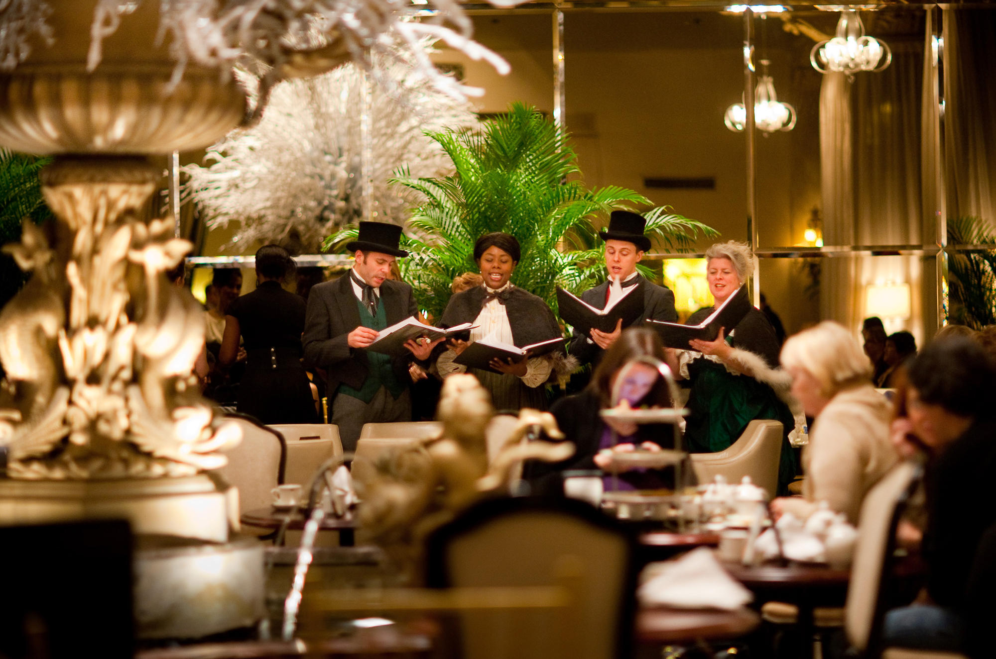 e6b65d33af Carolers sing during Christmas tea at the Drake Hotel in Chicago. In some  fancy hotels, Christmas tea has become a refined respite for harried holiday  ...