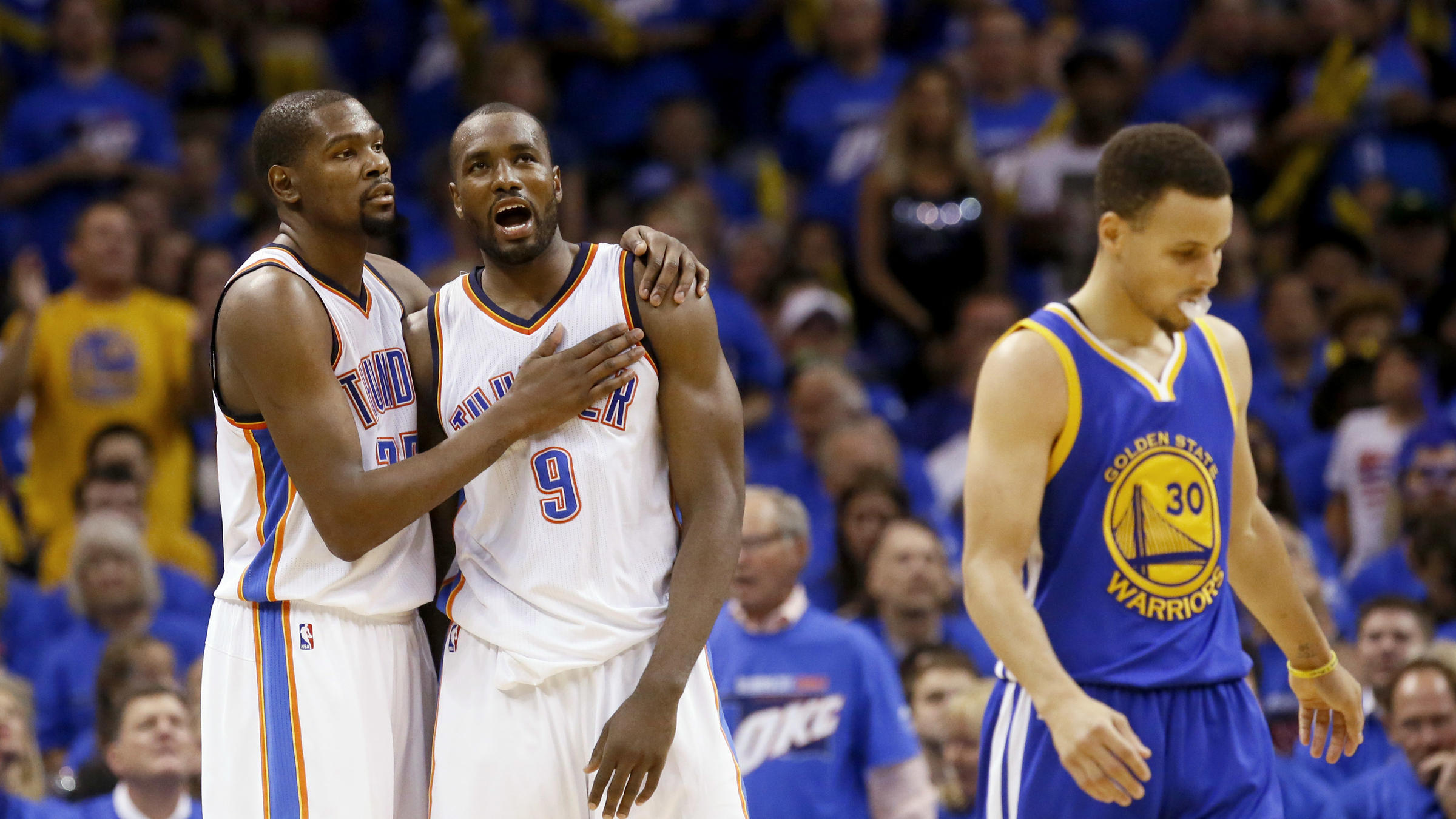 Kevin Durant (left) will leave the Oklahoma City Thunder to join the Golden  State Warriors and guard Stephen Curry (far right). a8be7e8e8