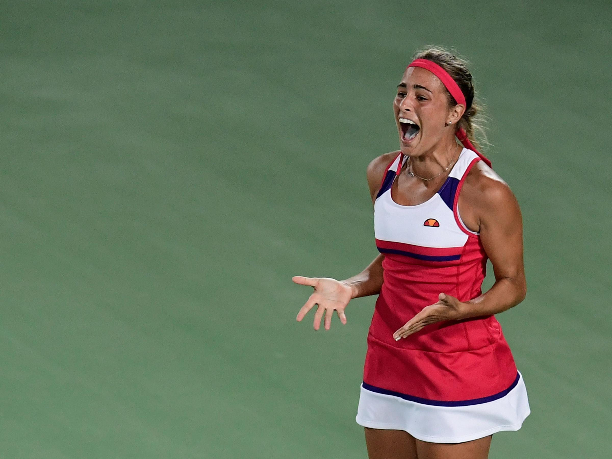ba17fe00f385 Puerto Rico s Monica Puig reacts after winning her women s singles final  tennis match against Germany s Angelique Kerber at the Olympic Tennis  Centre of the ...