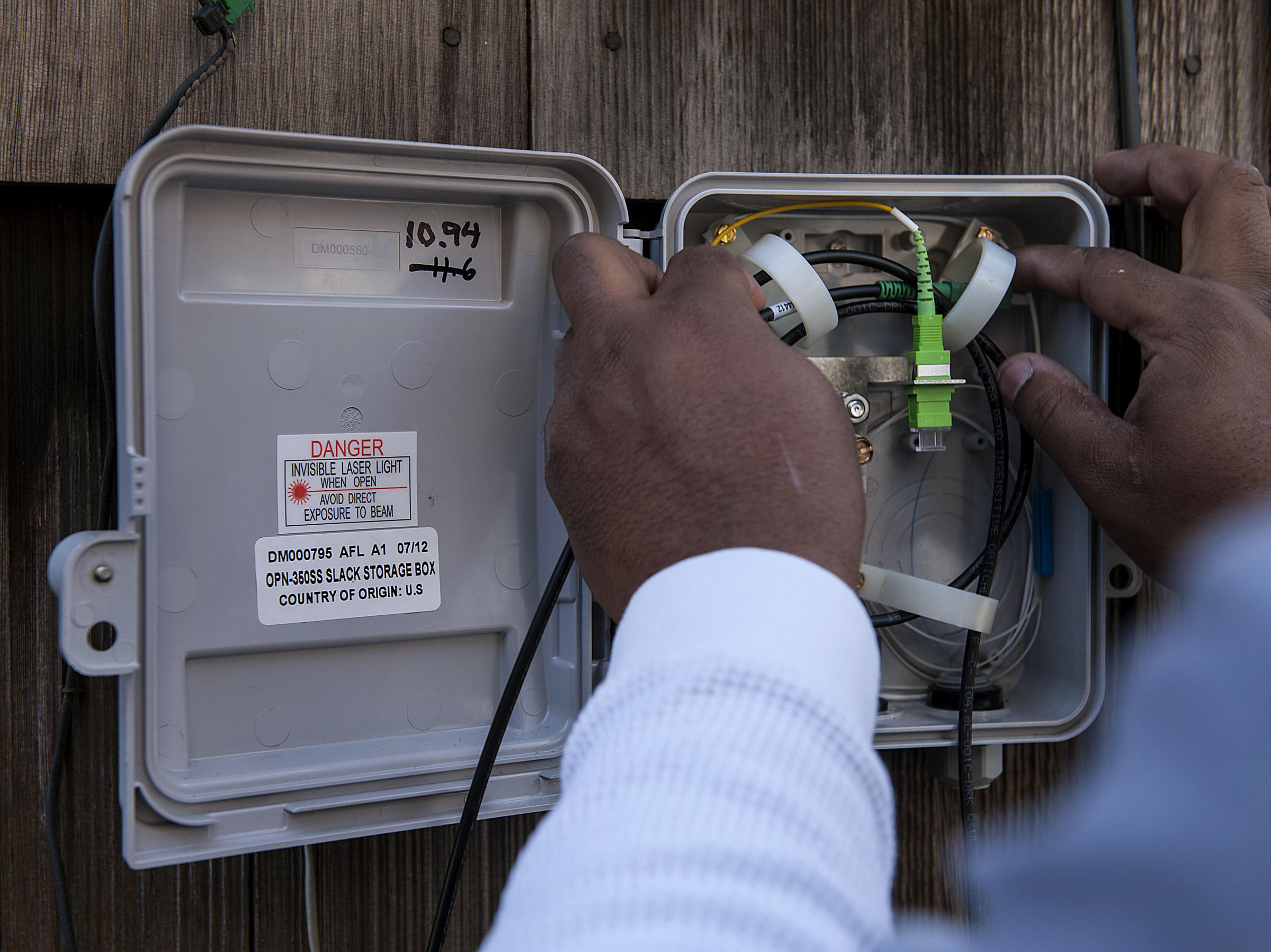 Google Fiber Wont Accept Any New Cities For Its Superfast Internet Home Media Wiring Box A Broadband Technician Installs Optic Network At Of One The Early Customers In Kansas City Kan 2012