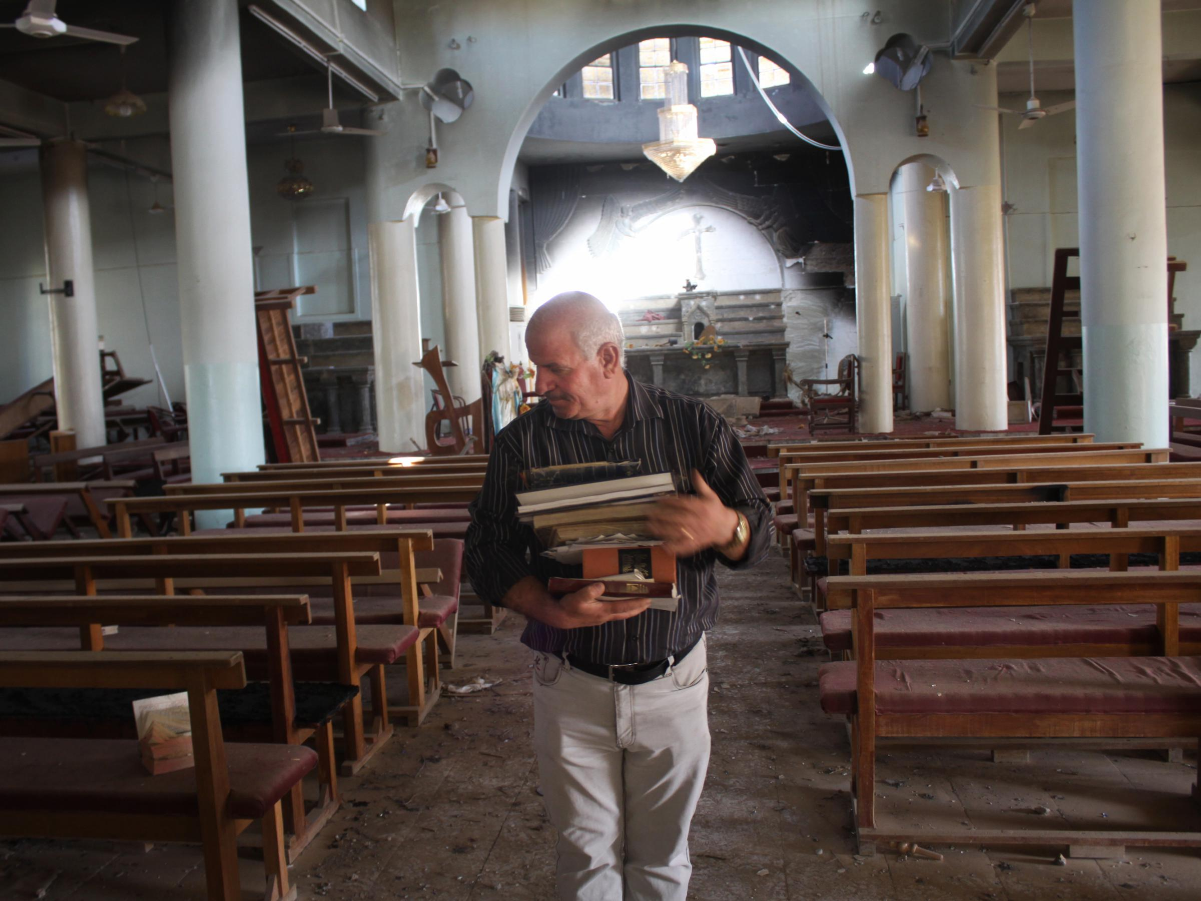 Khalid Yaako Touma, A School Teacher And Deacon In The Village Of  Karamlesh, Collects Religious Books From One Of The Churches In The Village  That ISIS ...