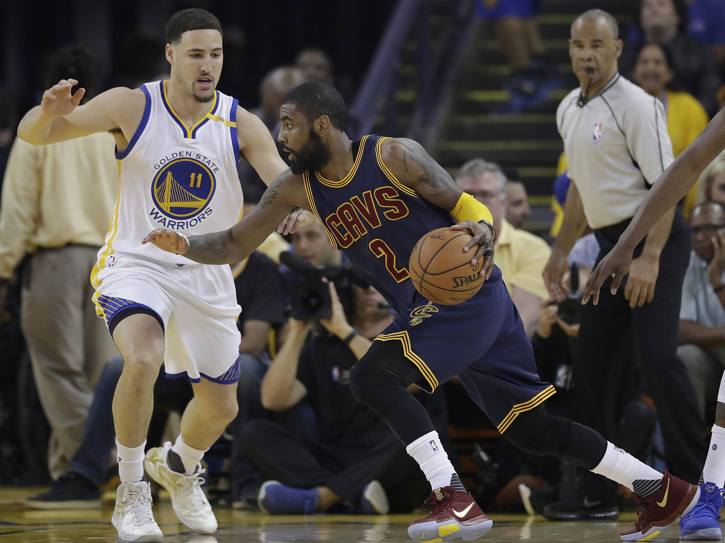 ef453cb1b959 Cleveland Cavaliers guard Kyrie Irving (2) drives against Golden State  Warriors guard Klay Thompson (11) during the first half of Game 1 of basketball s  NBA ...