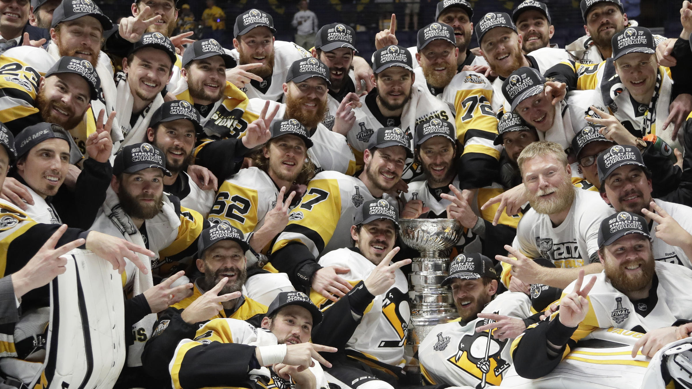 6ff12c701 Pittsburgh Penguins players celebrate Sunday after defeating the Nashville  Predators 2-0 in Game 6 of the NHL Stanley Cup Final in Nashville