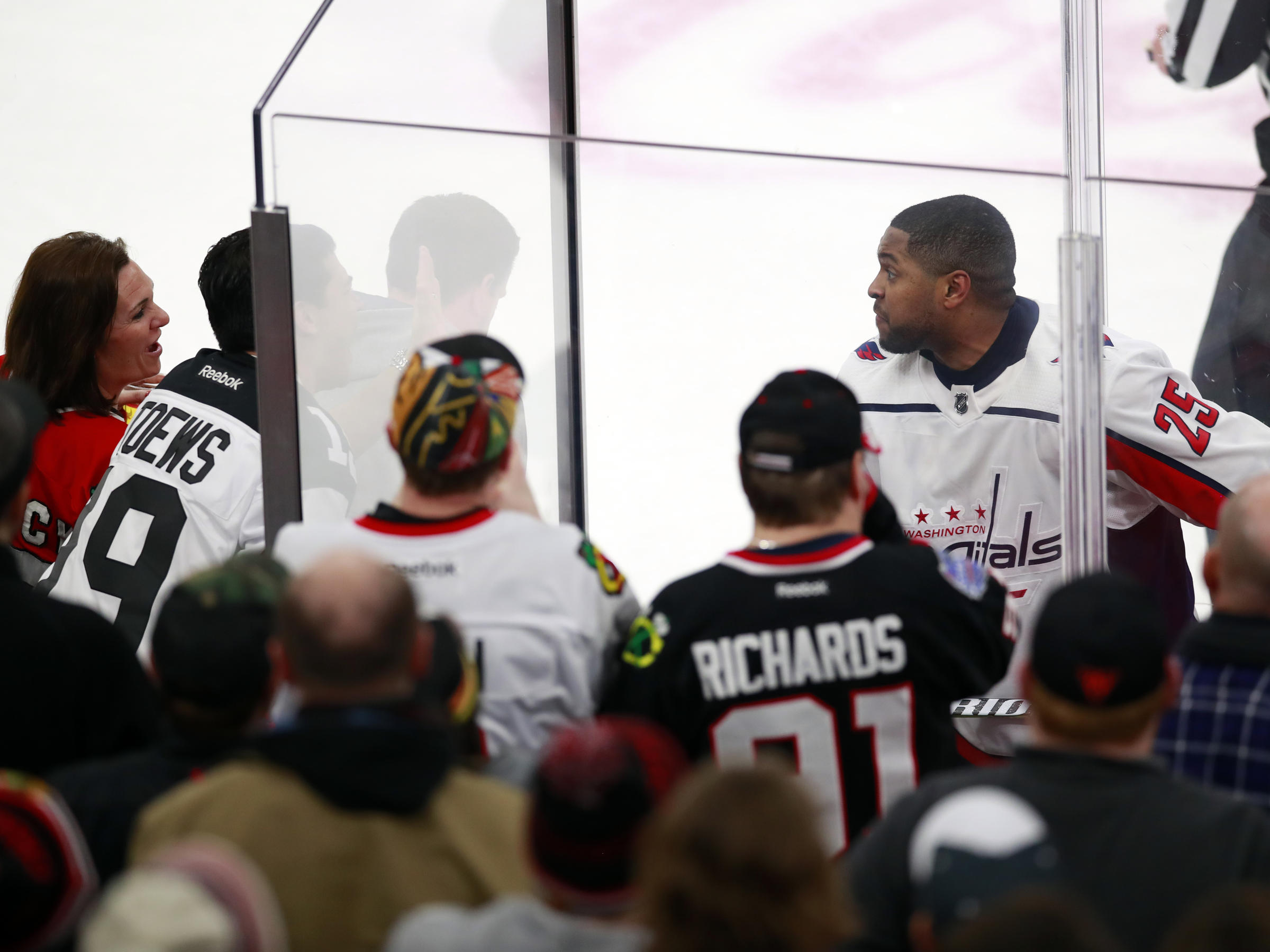 Washington Capitals right wing Devante Smith-Pelly (25) approaches Chicago  Blackhawks fans who were racially taunting him during a game in Chicago. 5458b1c0870