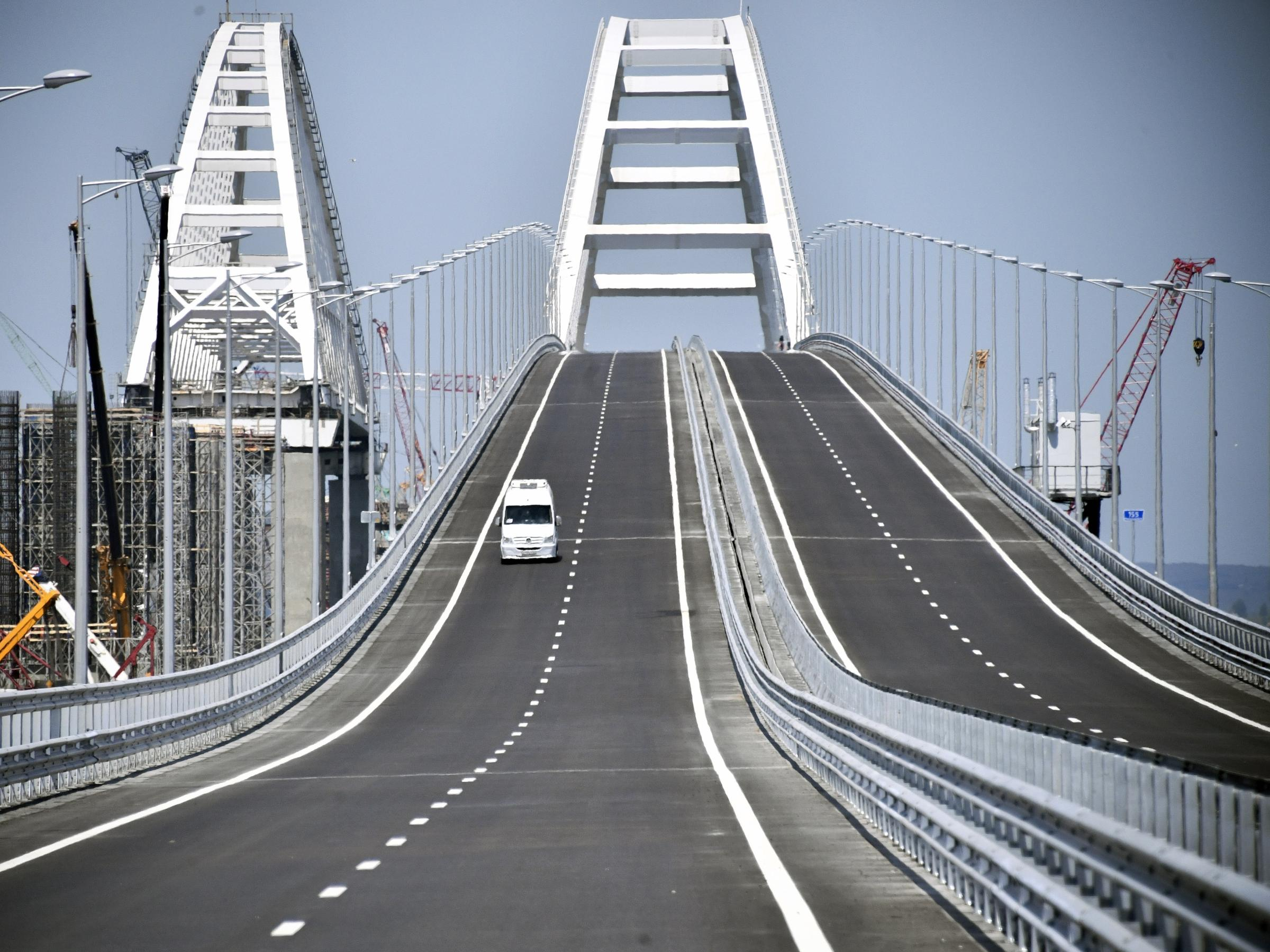 Putin Opens New Bridge, Defies The World
