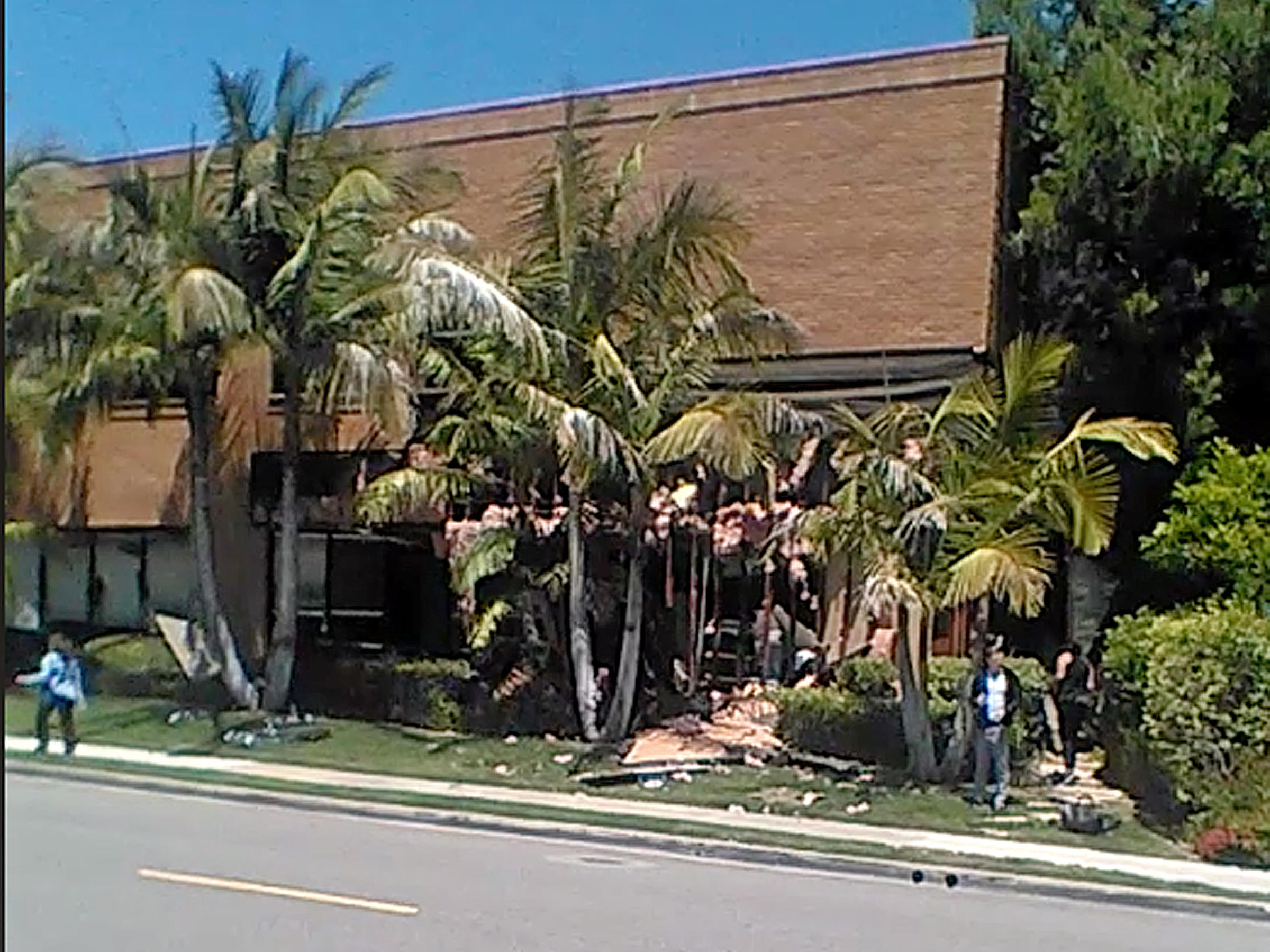 This image taken from cellphone video shows a building after a fatal explosion in Aliso Viejo Calif. on Tuesday. The cause of the blast is being investigated