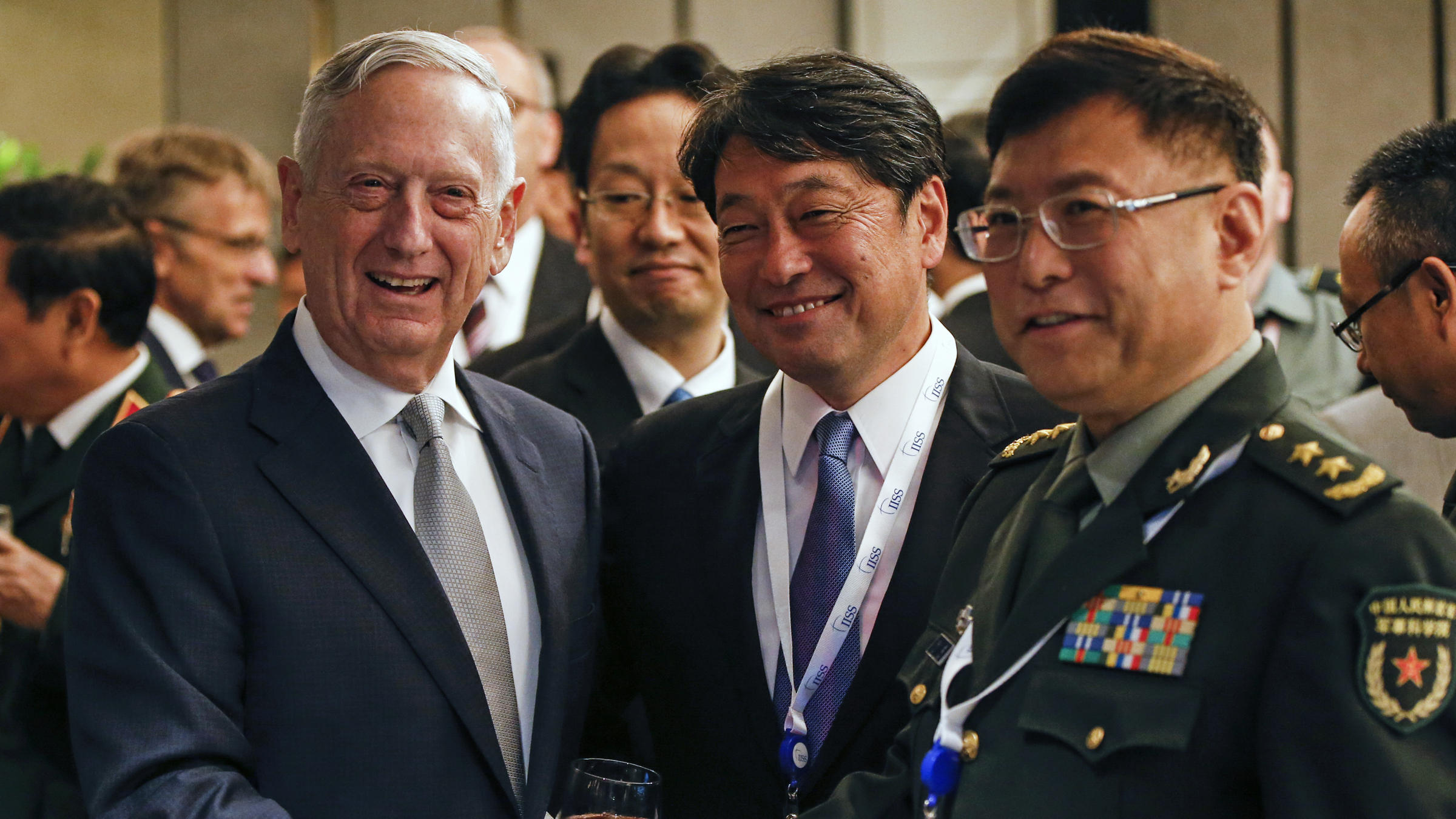 From left U.S. Defense Secretary Jim Mattis Japan's Defense Minister Itsunori Onodera and China's People's Liberation Army's Academy of Military Science Deputy President He Lei pose for