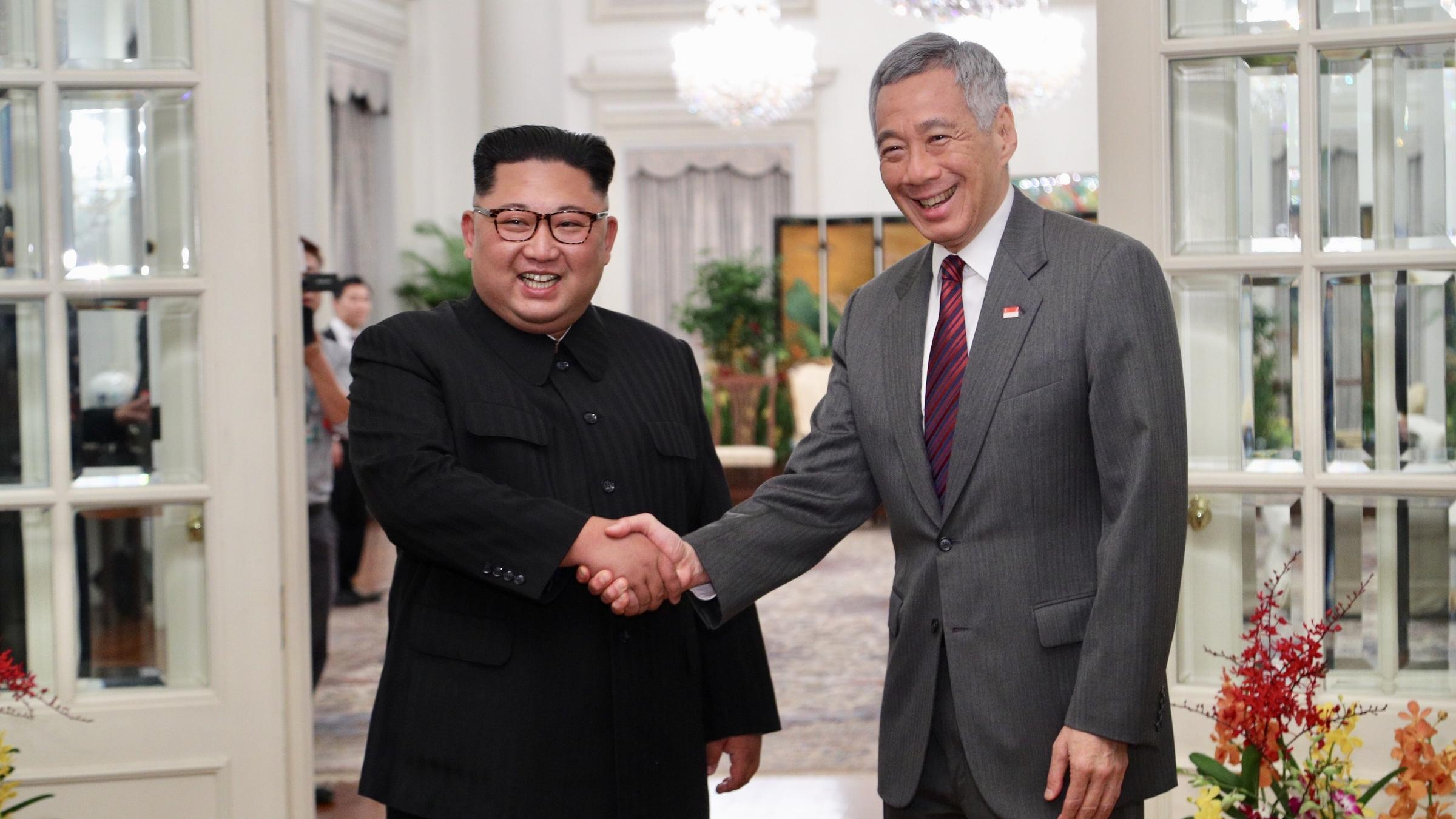 North Korea's Kim Jong Un meets Singaporean Prime Minister Lee Hsien Loong Sunday. Kim is scheduled to begin a summit Tuesday with President Trump