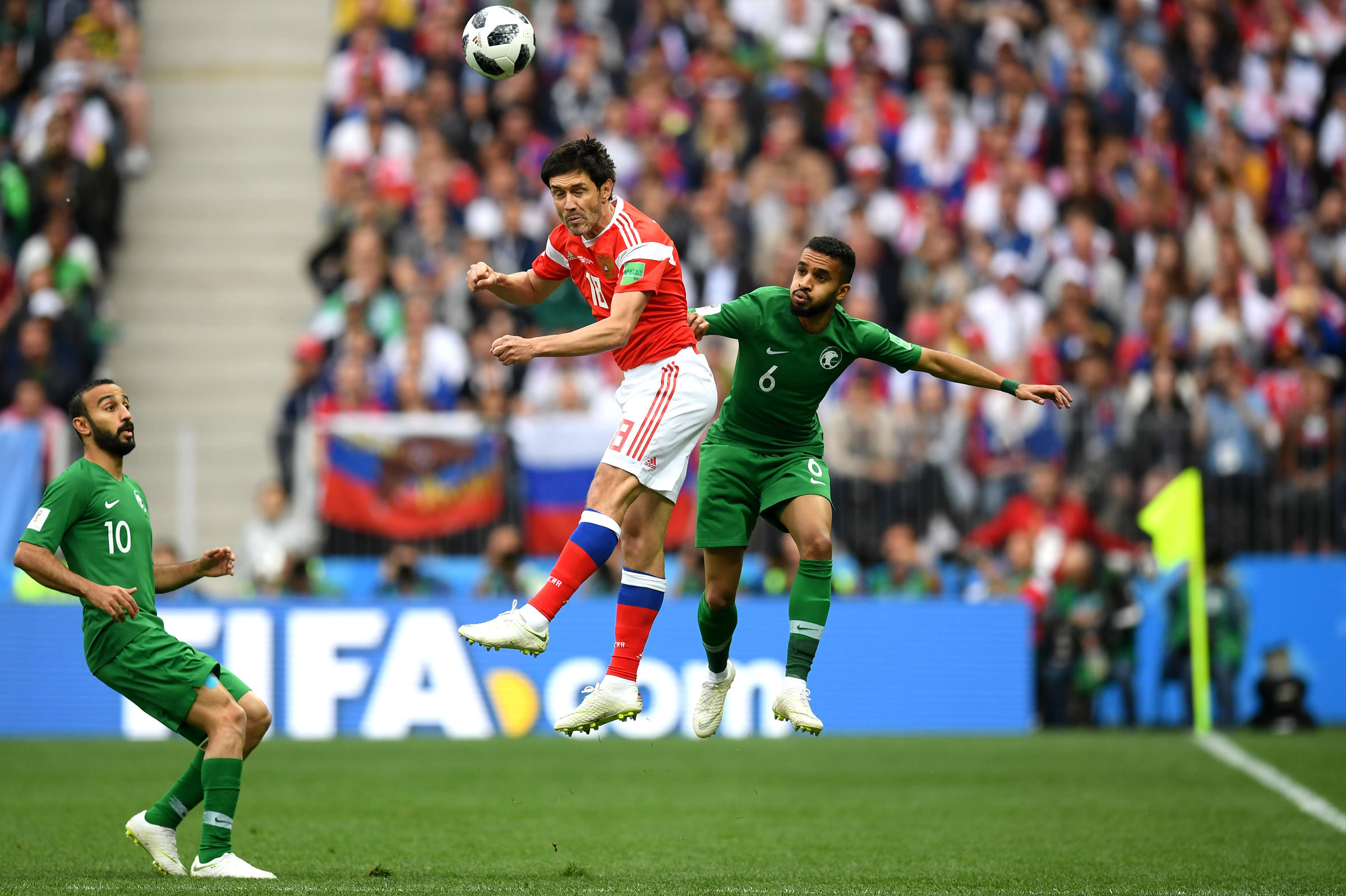 Yury Zhirkov of Russia wins a header Mohammed Alburayk of Saudi Arabia  during the 2018 FIFA World Cup Russia Group A match between Russia and  Saudi Arabia ... a5701c248
