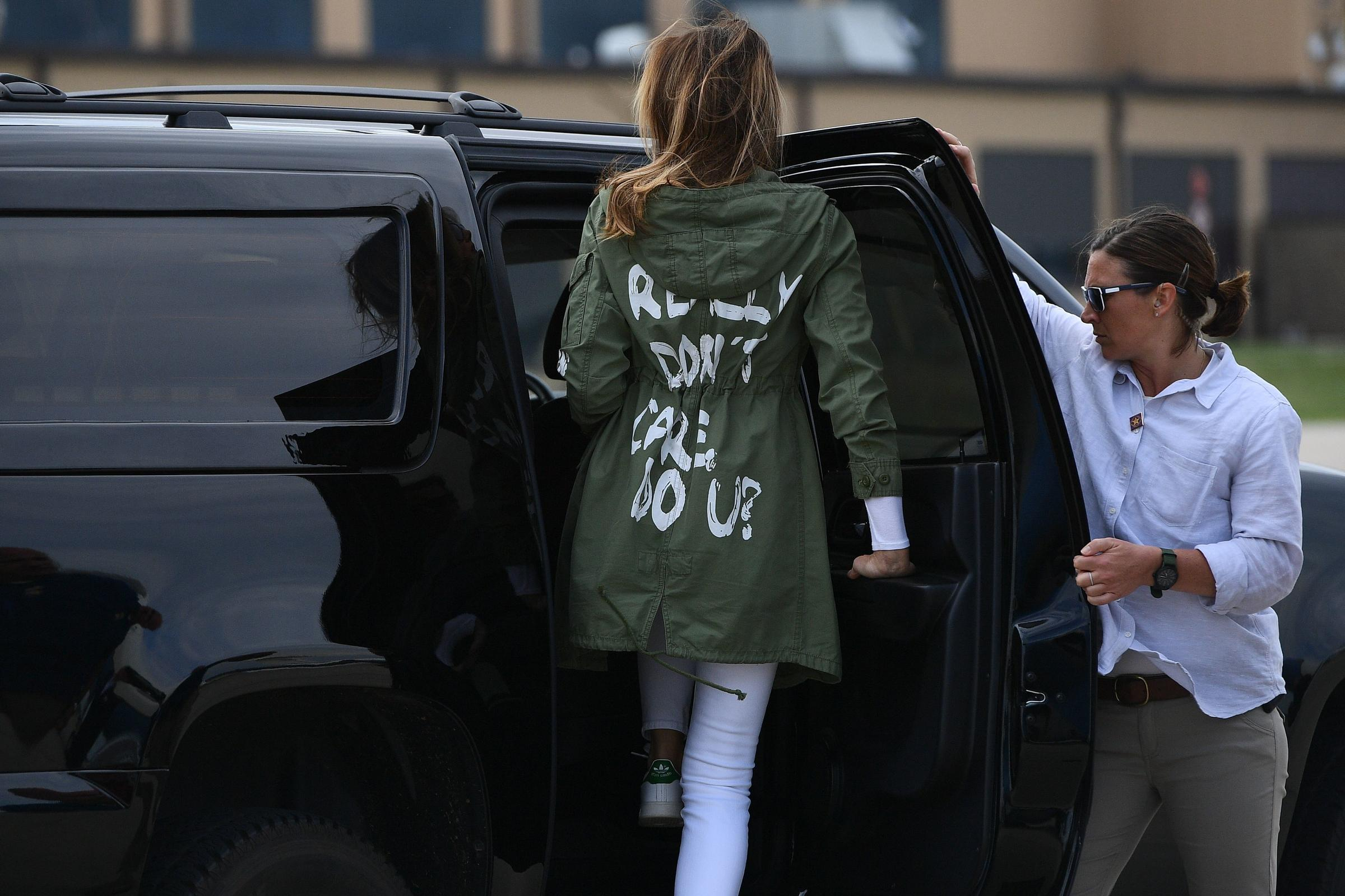 First lady Melania Trump leaves Joint Base Andrews in Maryland wearing a jacket with the words