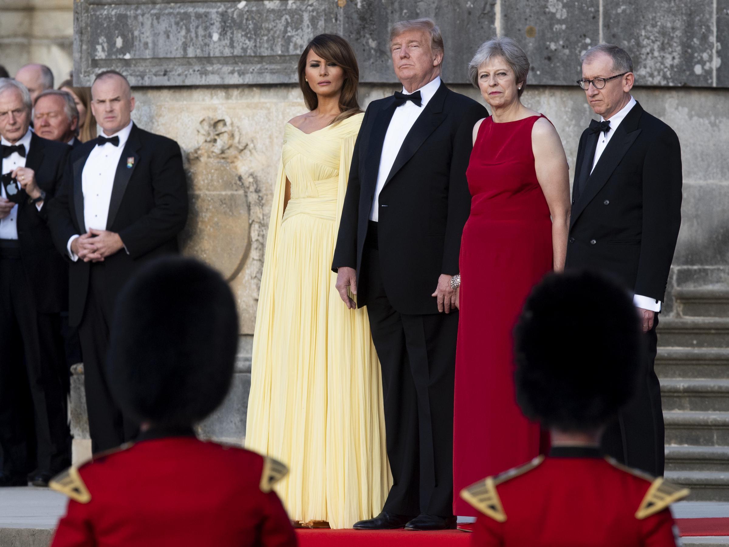 U.S. first lady Melania Trump President Trump British Prime Minister Theresa May and her husband Philip May watch a live military performance ahead of a dinner in Oxfordshire U.K. on Thursday