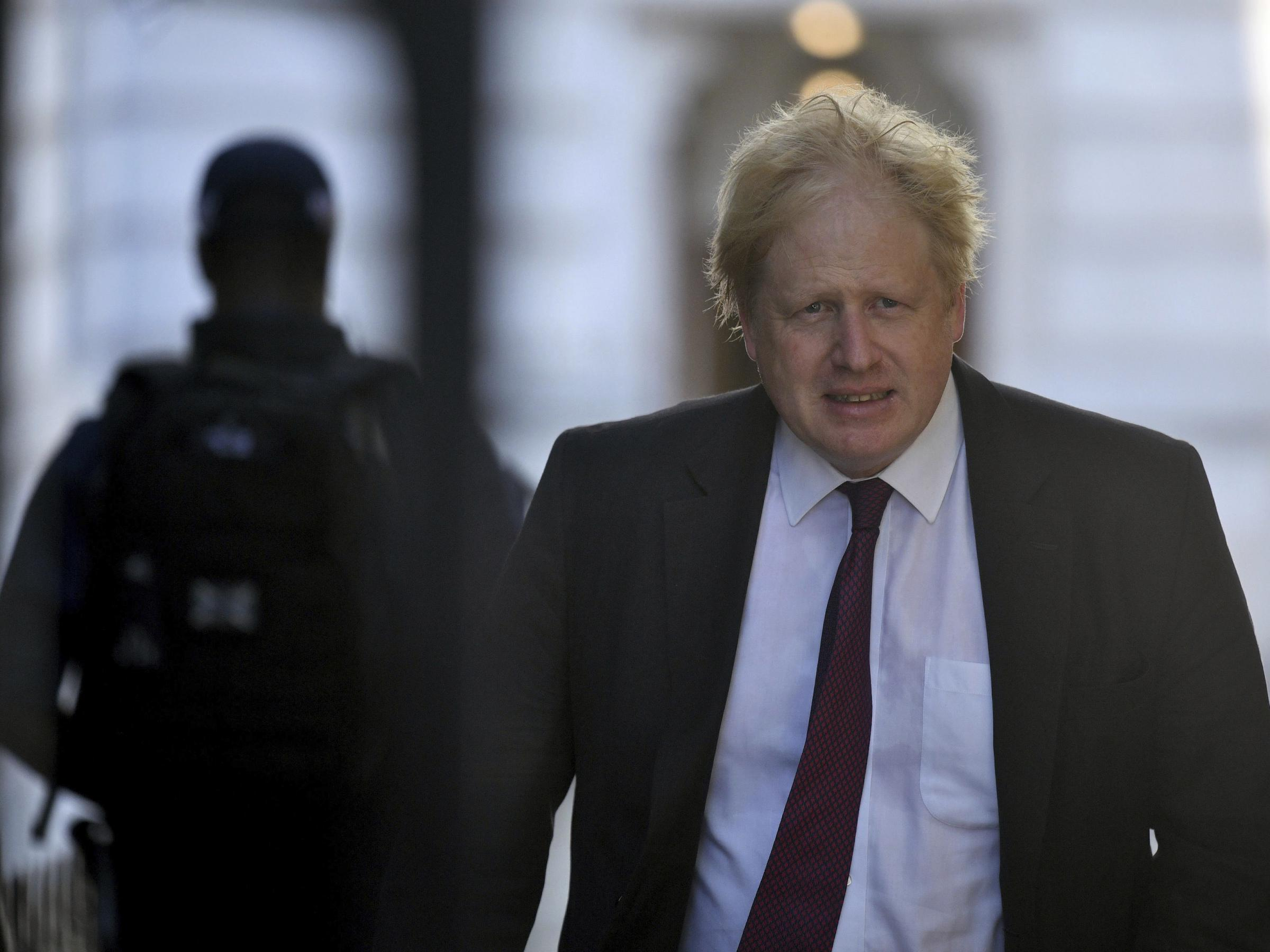 Britain's Foreign Secretary Boris Johnson who resigned this week leaves the Foreign Office on his way to Downing Street for a Cabinet meeting in London on Tuesday