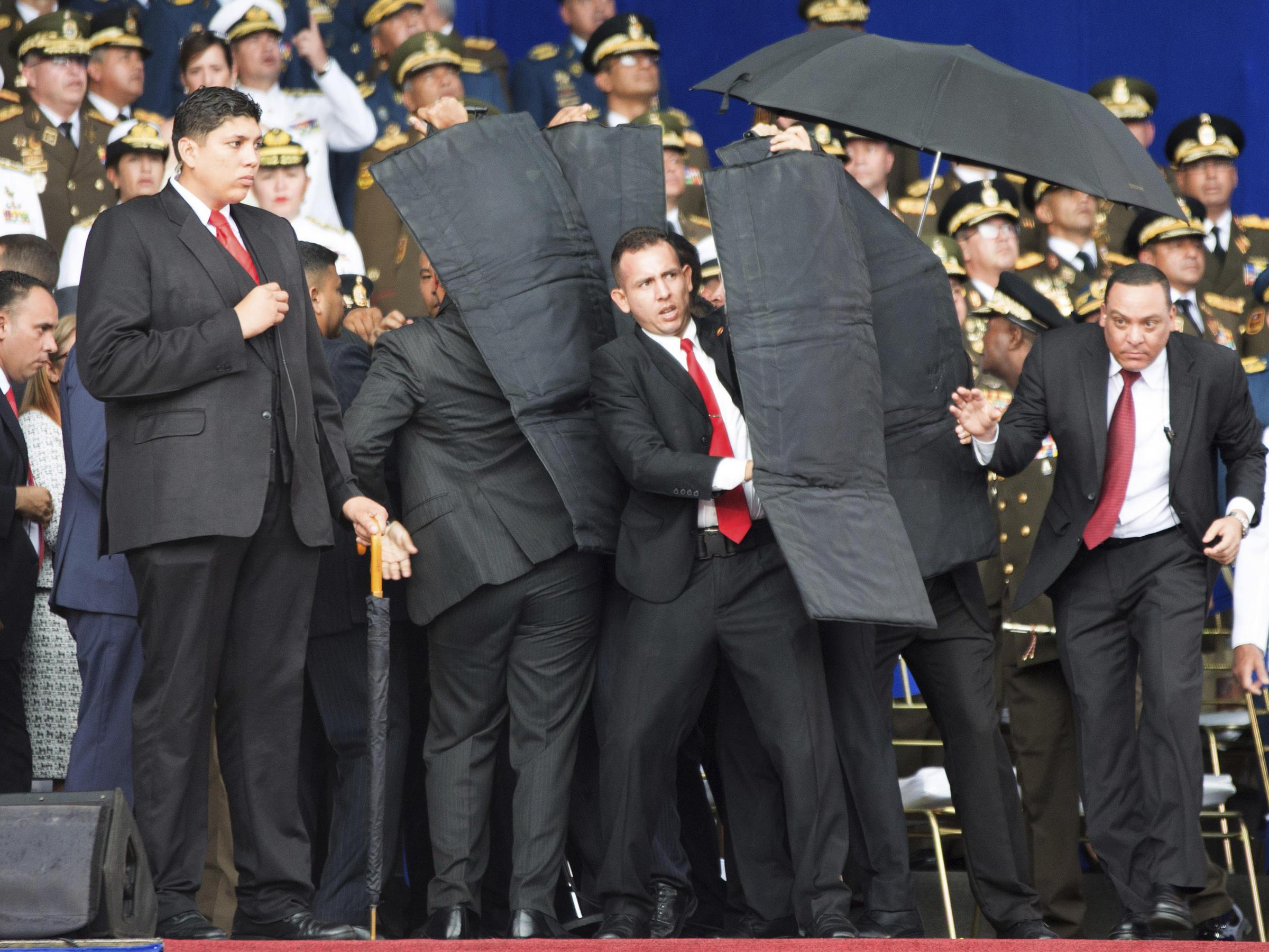 Security Personnel Surround Venezuelas President Nicolas Maduro After Explosives Laden Drones