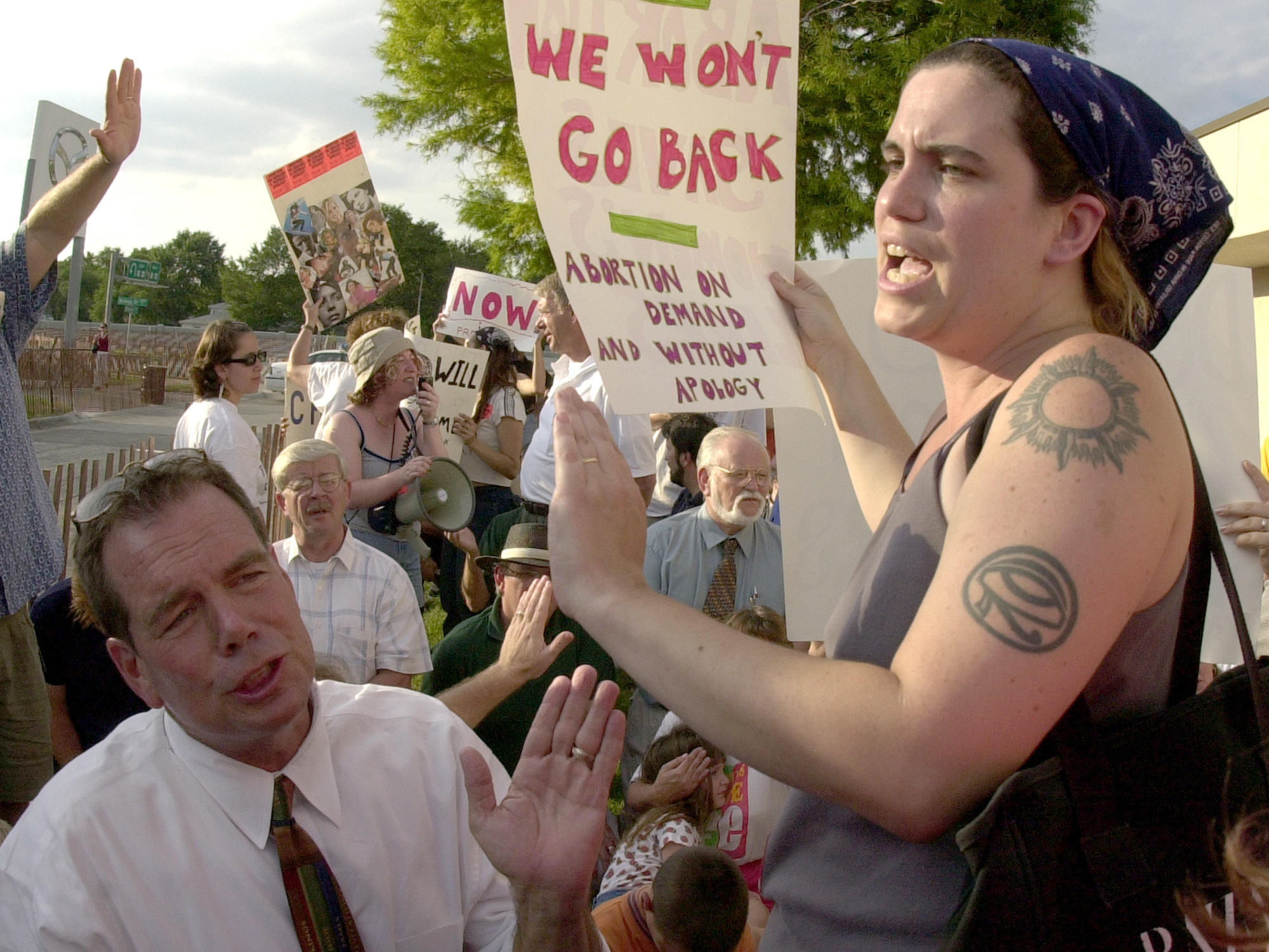 Abortion-rights activist Karen Nicholls confronts anti-abortion leader the Rev. Flip Benham in 2001 during protests by the two groups at a Wichita Kan. medical clinic operated by Dr. George Tiller who performed abortions