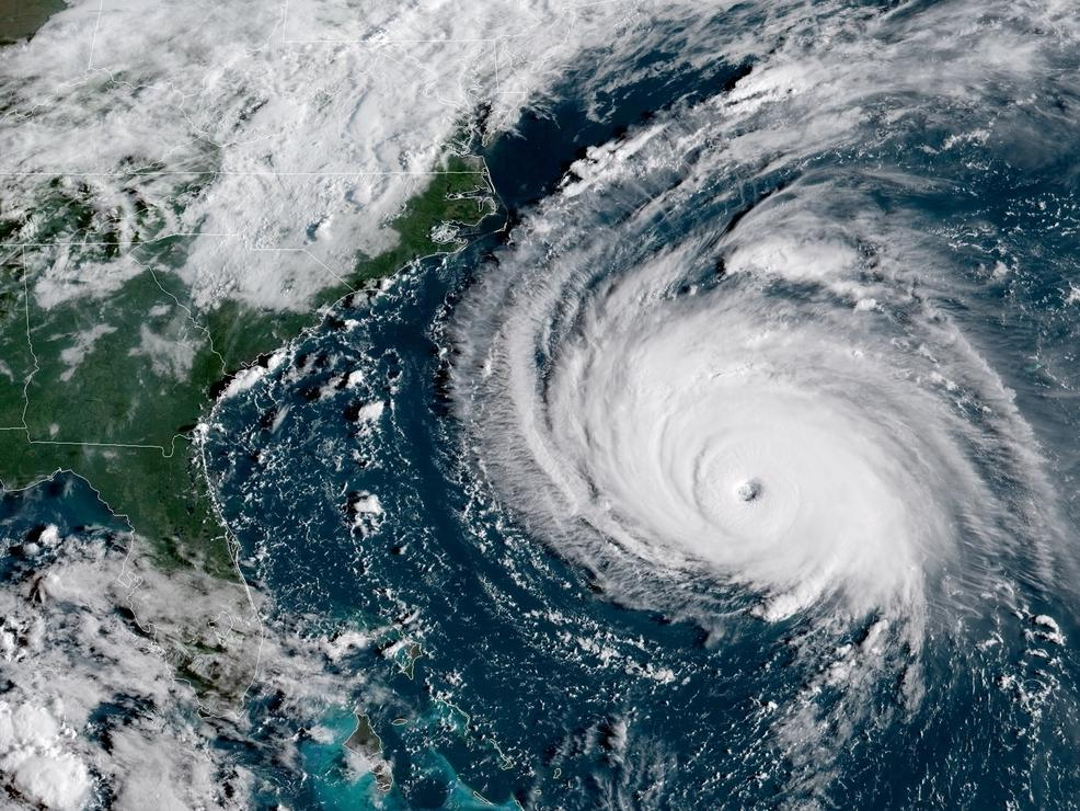 A satellite image shows Hurricane Florence looming in the Atlantic Ocean as the sun rises over the U.S. Florence is expected to bring tropical storm conditions to North Carolina and South Carolina on Thursday