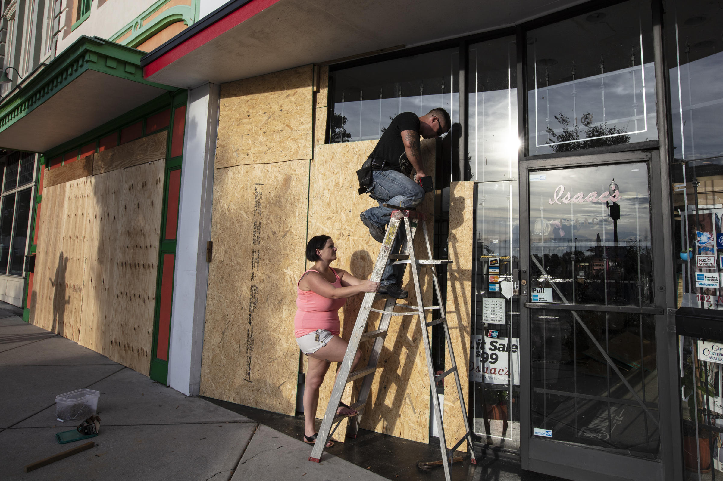 Jacob Harrelson and his wife Beth install protective plywood on a local business in anticipation of Hurricane Florence in Wilmington N.C. on Wednesday