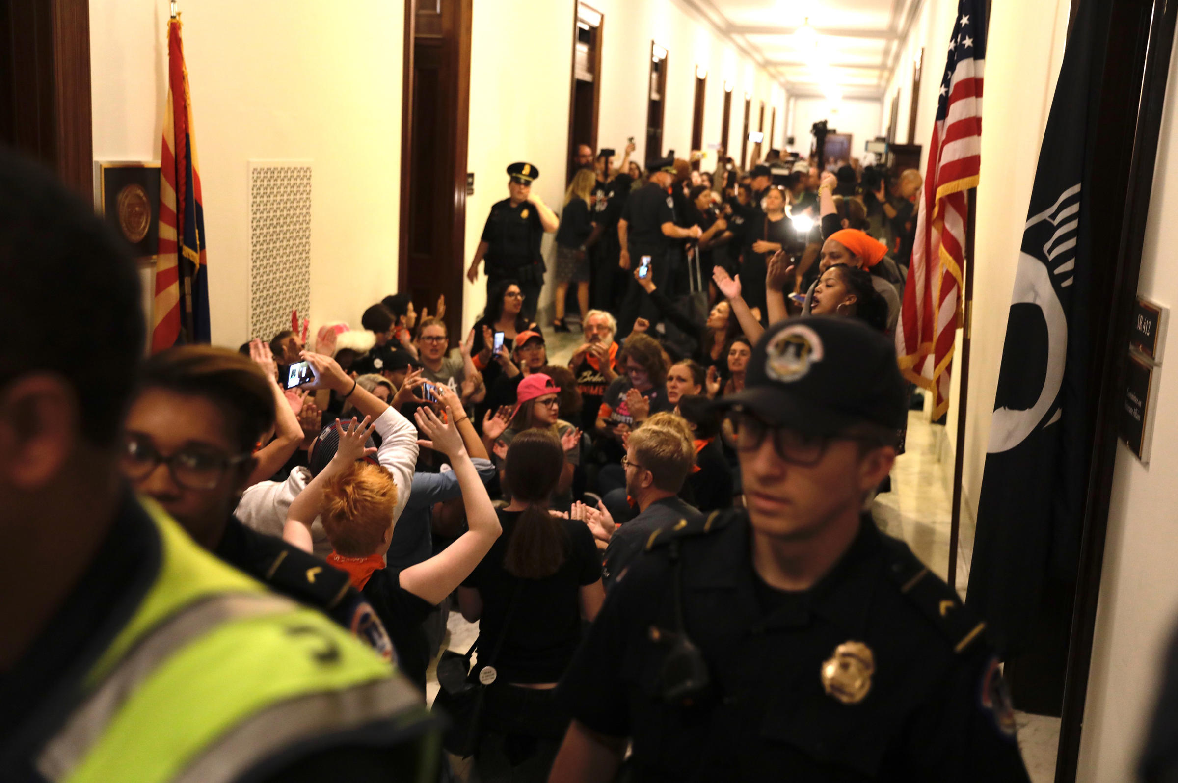 Protesters gather outside Flake's office not long after the Republican voted to advance Brett Kavanaugh's nomination. Flake's was not the only office visited by demonstrators Friday. Other senators who had been considered on the fence also