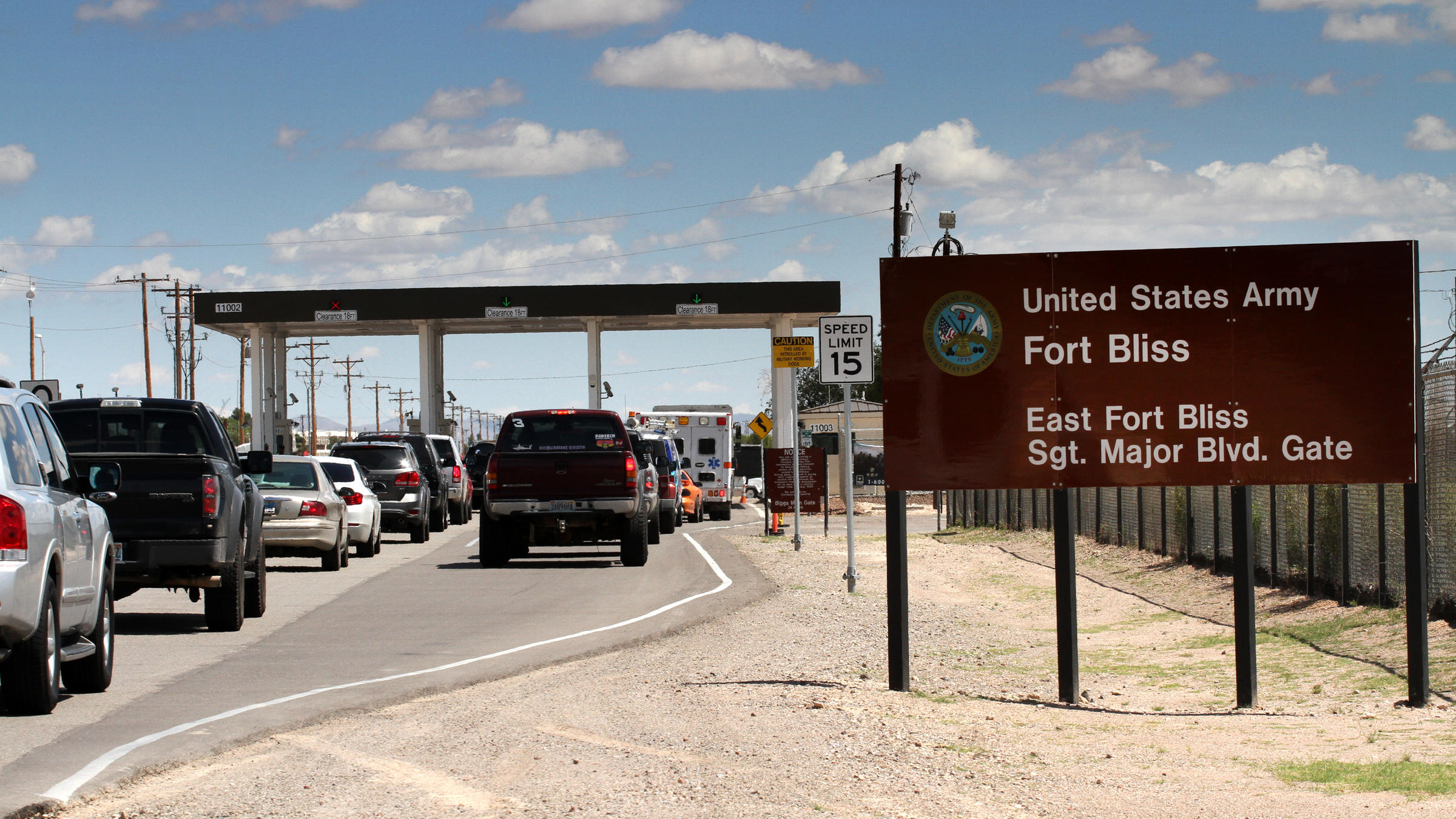 Cars wait to enter Fort Bliss in El Paso, Texas, in 2014. The