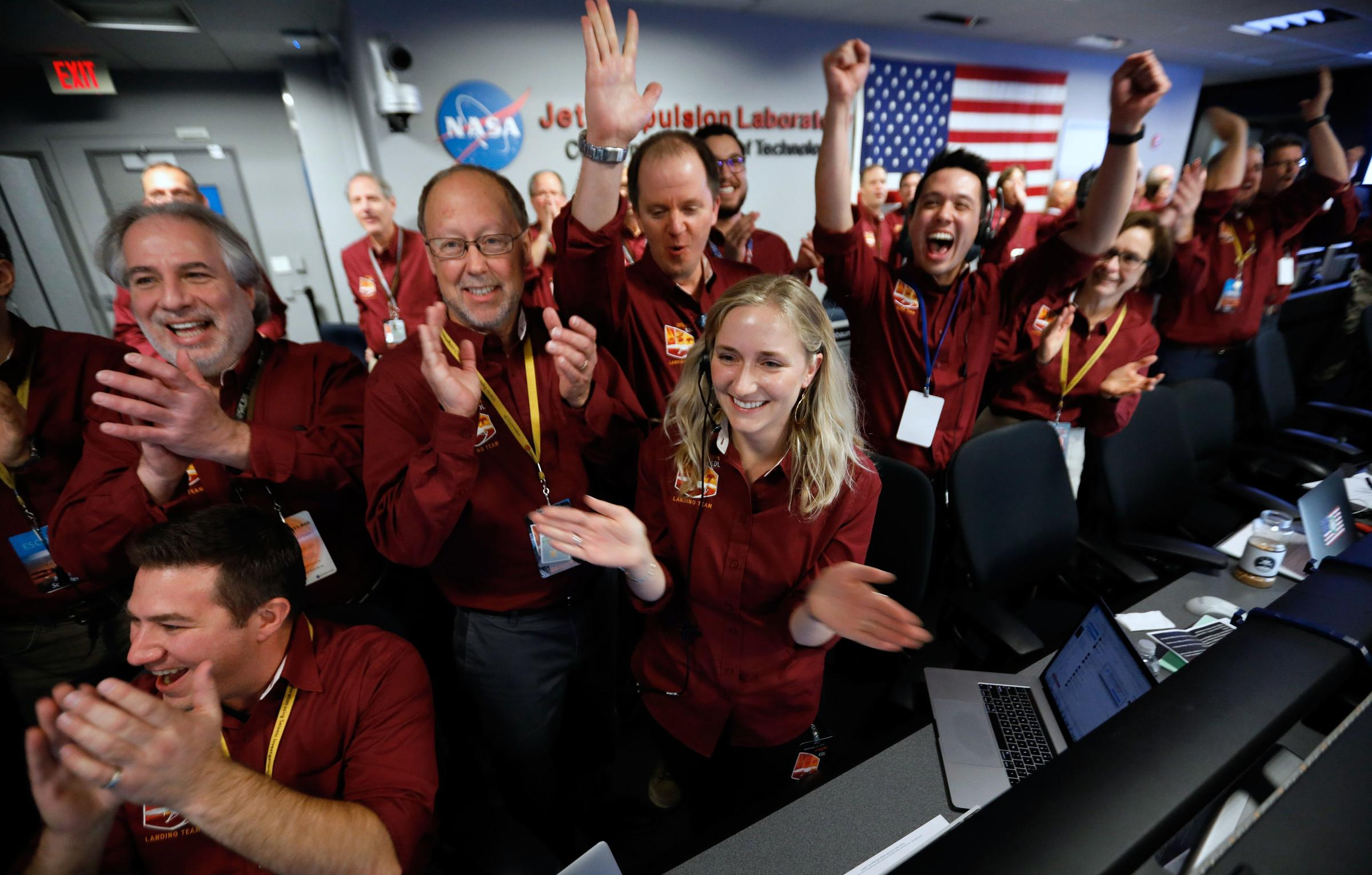 NASA engineers on the flight team celebrate the In Sight spacecraft's successful landing on Mars at the NASA Jet Propulsion Laboratory in Pasadena Calif. on Monday