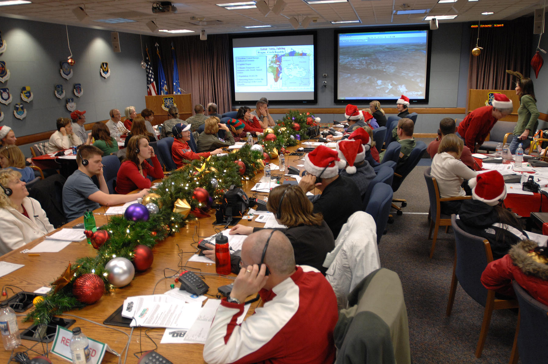 NORAD volunteers answer phone calls to their Santa hotline in 2007. The tradition of tracking Santa on his trip around the world started in 1955 by accident