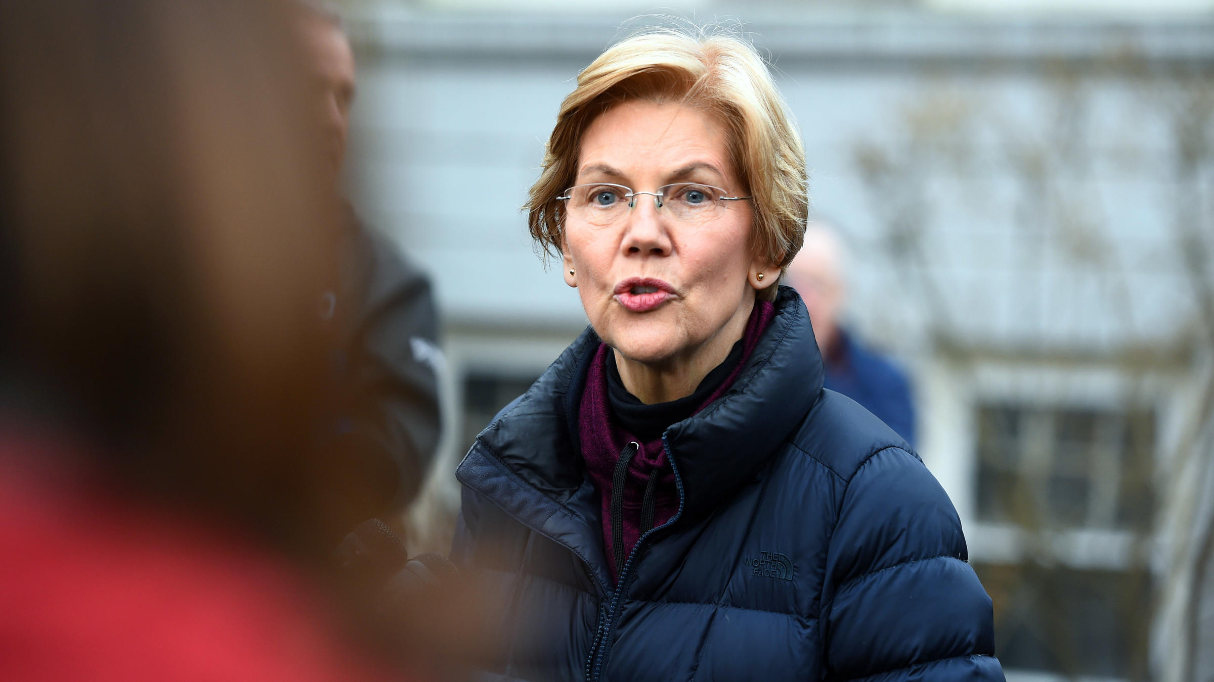 Massachusetts Sen. Elizabeth Warren speaks to reporters outside her home in Cambridge Mass. on Dec. 31 after announcing plans to explore a campaign for the 2020 Democratic presidential nomination
