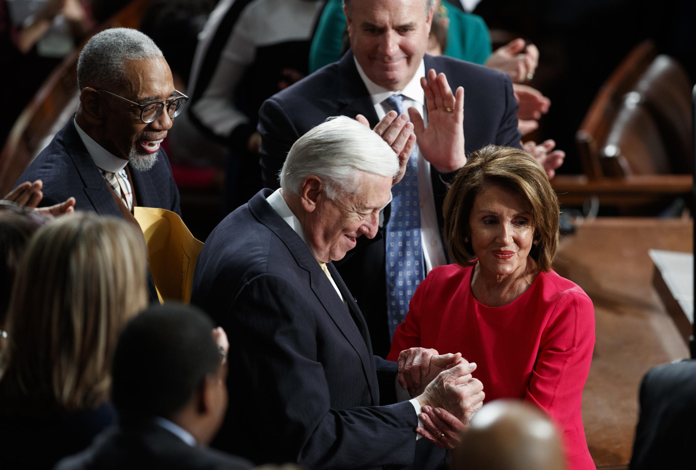 New Speaker of the House Nancy Pelosi D-Calif. and House Majority Leader Steny Hoyer D-Md. are applauded at the Capitol on Thursday as Democrats officially regain control of the chamber