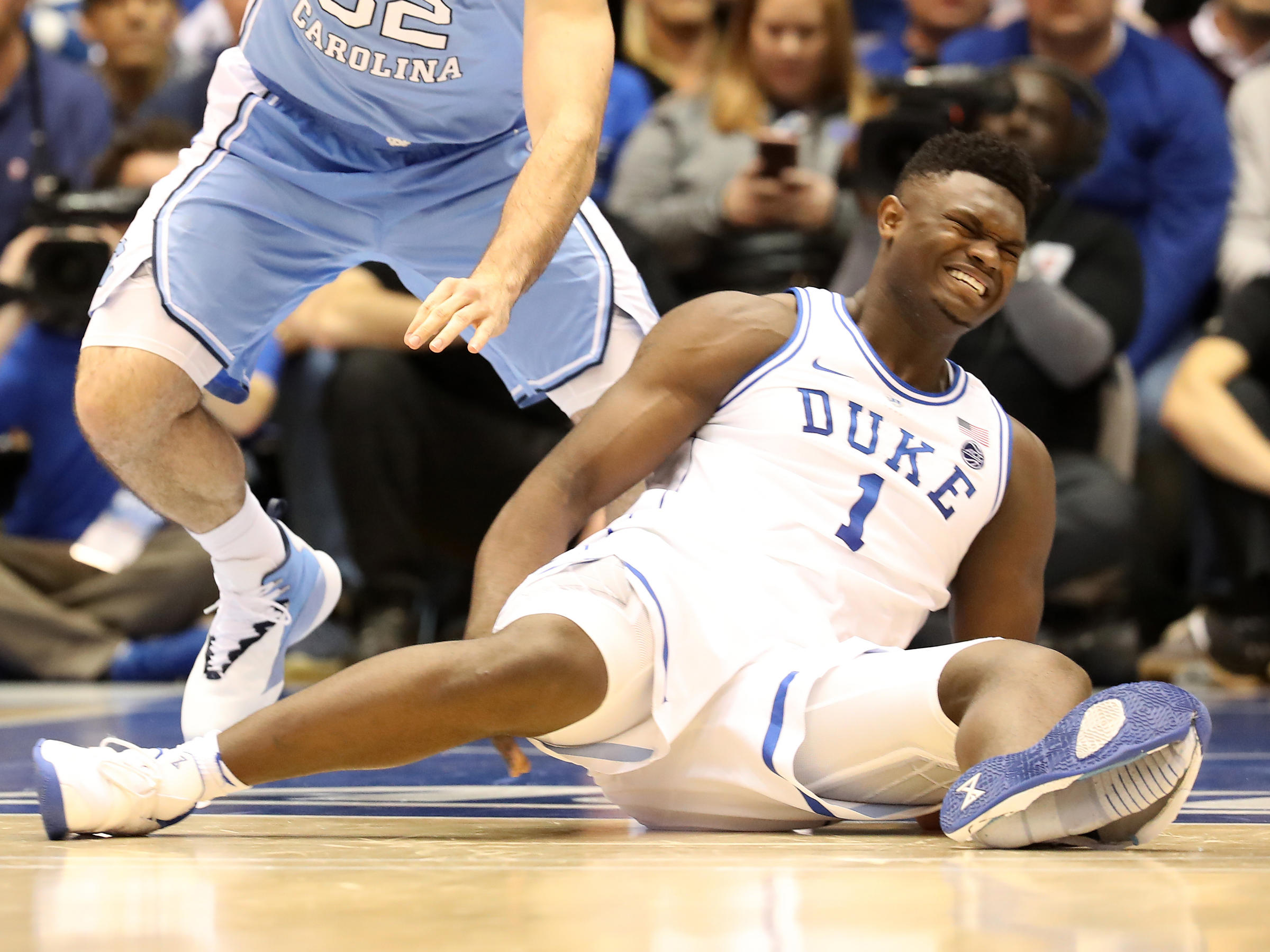 newest fc880 bfca2 Dukes Zion Williamson reacts after falling as his shoe breaks in the game  against the North Carolina Tar Heels Wednesday in Durham, N.C.