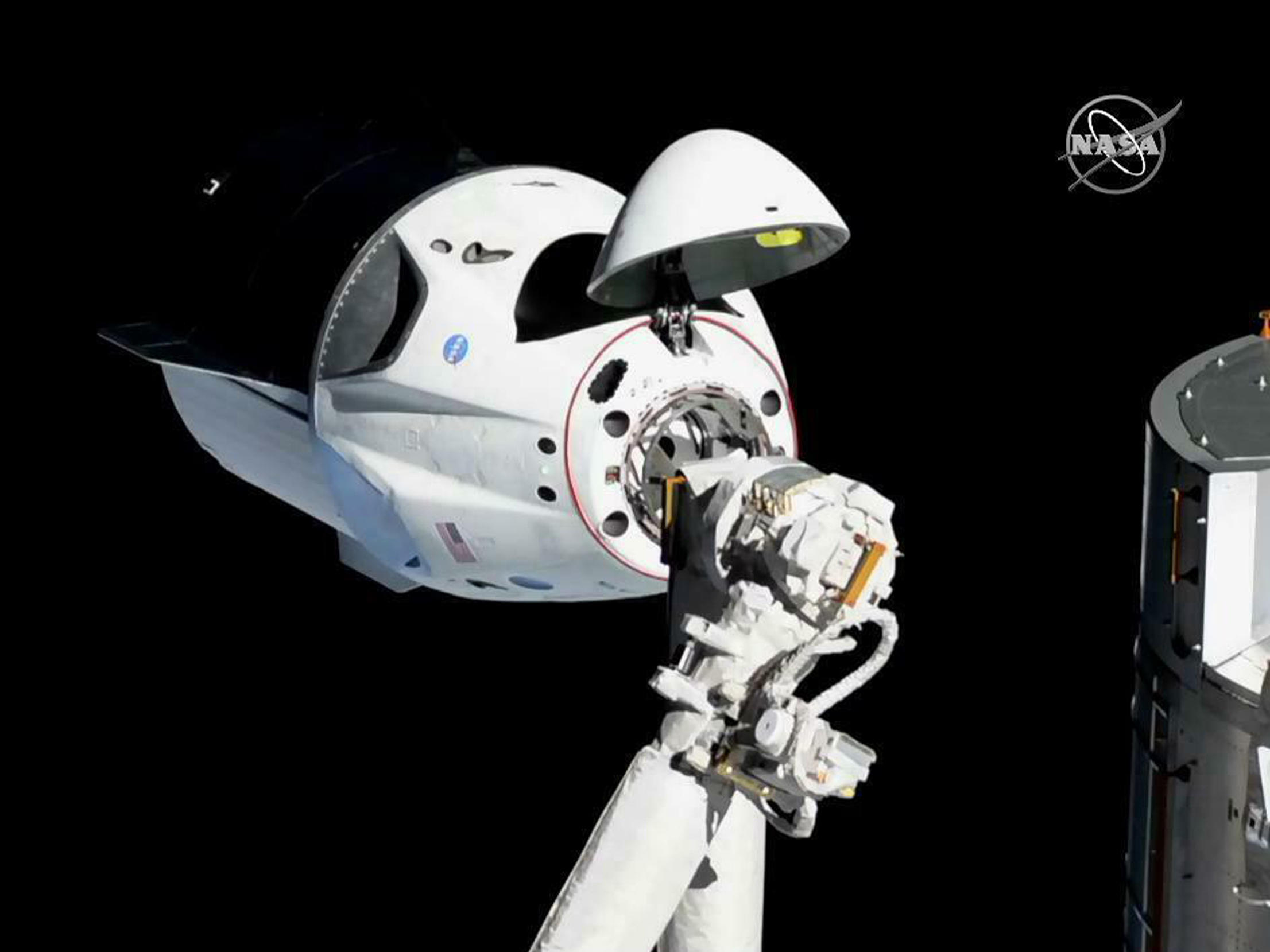 SpaceX capsule docks with space station