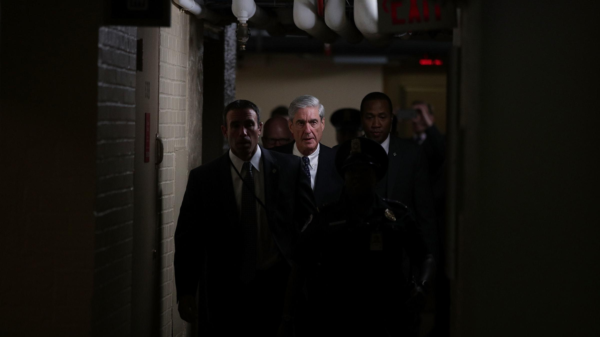 Special counsel Robert Mueller center leaves after a closed meeting with members of the Senate Judiciary Committee