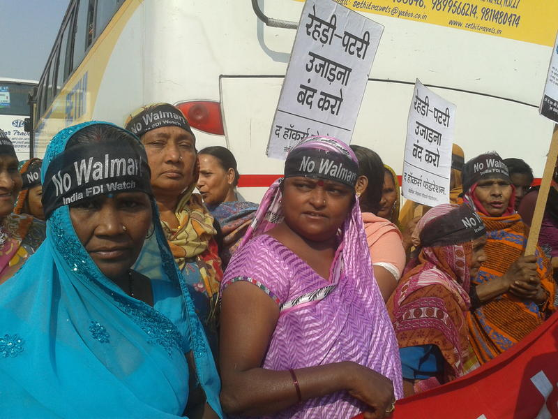 "<p>Women wearing ""No Walmart"" head bands at a protest outside Walmart India offices in Gurgaon, India</p>"
