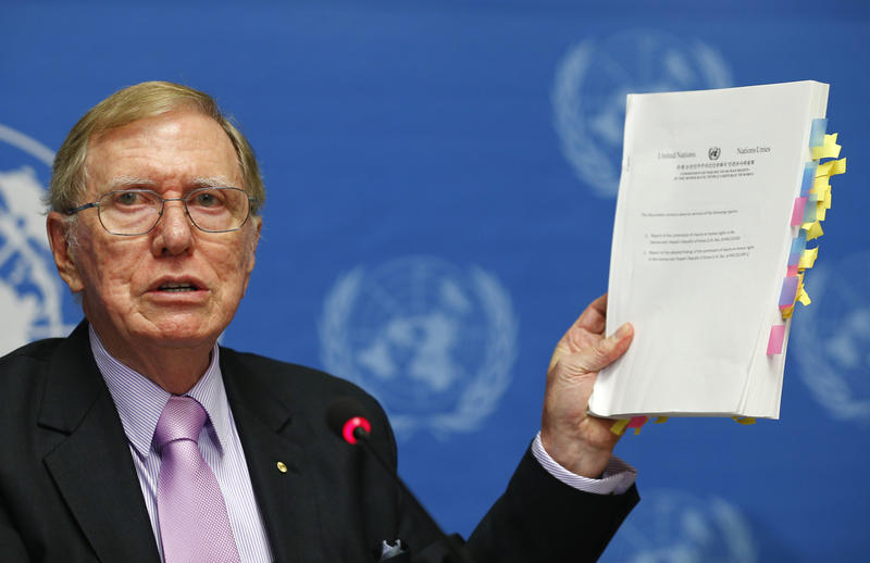 <p>Michael Kirby, who helped lead the Commission of Inquiry on Human Rights in North Korea, holds a copy of his report during a news conference at the United Nations in February 2014.</p>