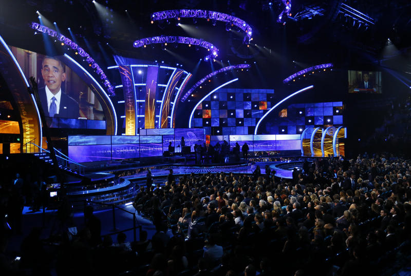 <p>President Barack Obama is shown on a large screen as he delivers his immigration speech from the White House before the start of the 15th Annual Latin Grammy Awards in Las Vegas on November 20, 2014.</p>