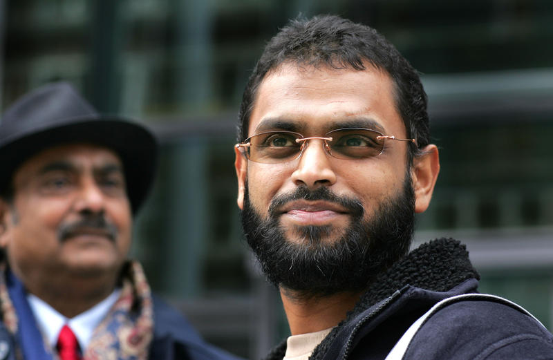 <p>Freed Guantanamo Bay detainee Moazzam Begg stands outside the Home Office with his father, Azmat, after delivering a petition in London on March 14, 2005.</p>